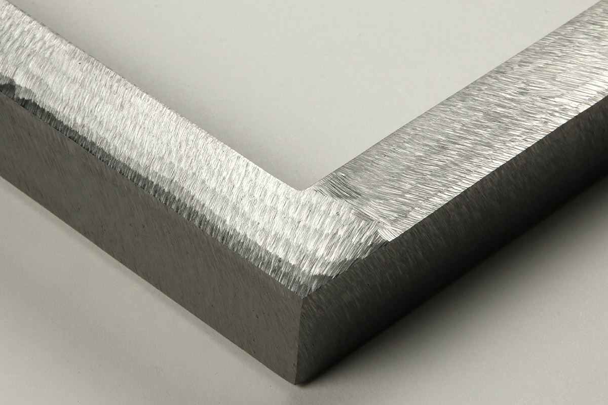 """Detail of an 1"""" wide molding steel frame with ground gloss finish"""