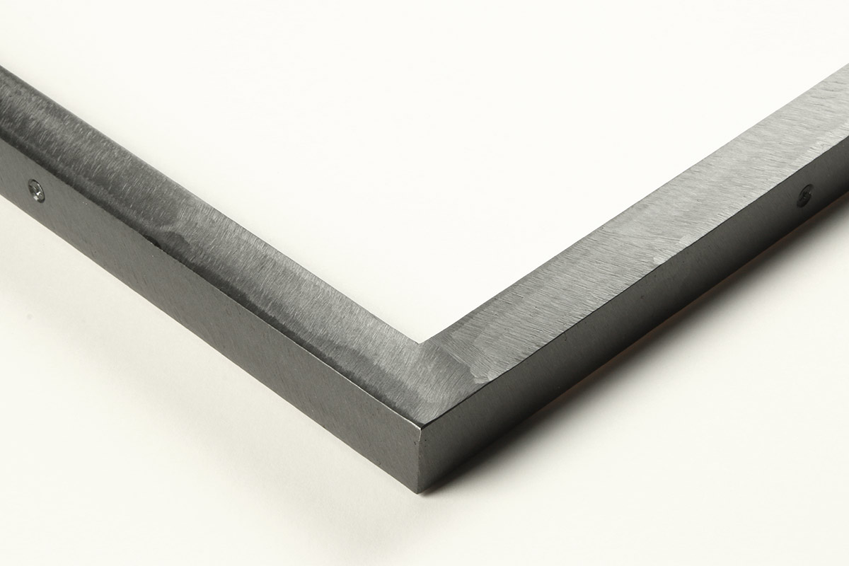 """Detail of a 0.75'"""" wide molding steel frame with ground gunmetal"""