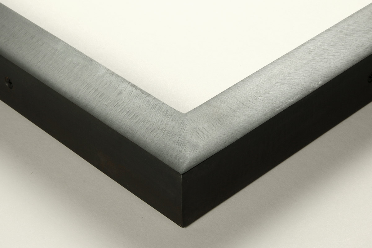 """Detail of an 1.25"""" wide molding steel frame with carbon finish"""