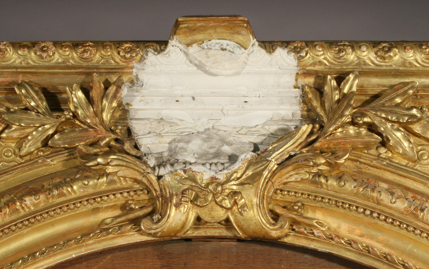 Giltwood frame mirror detail before conservation