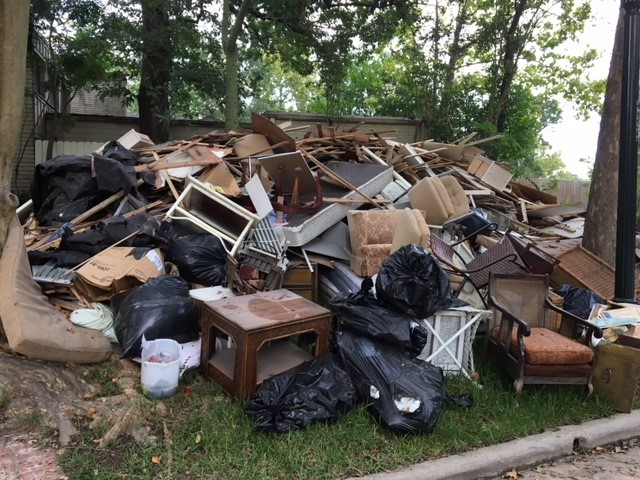…we all moved everything to the front yard. The pile of belongings in the front yard grew with each day…