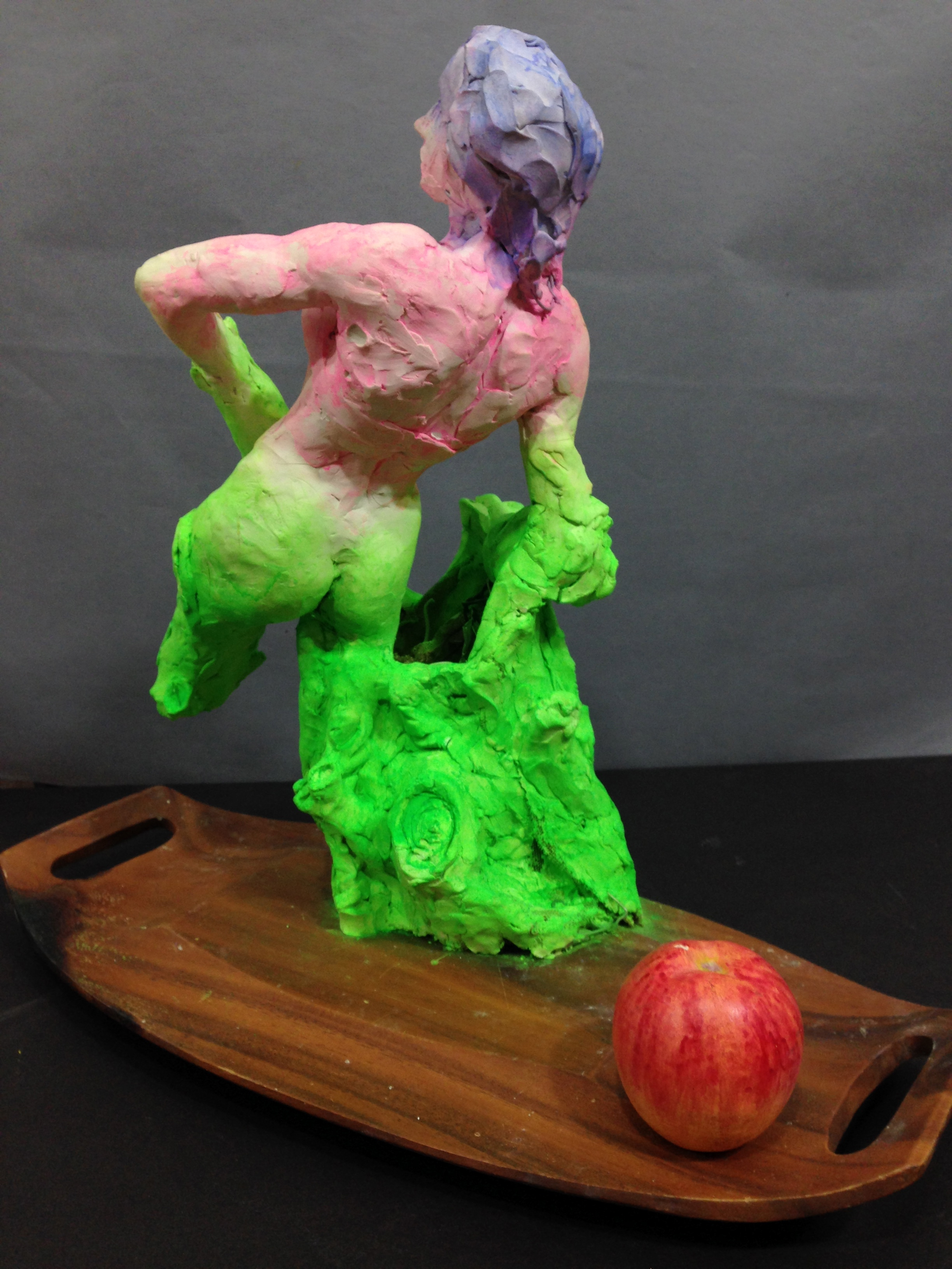 Daphne 2018, pigments, clay, faux painted apple on wood tray plinth