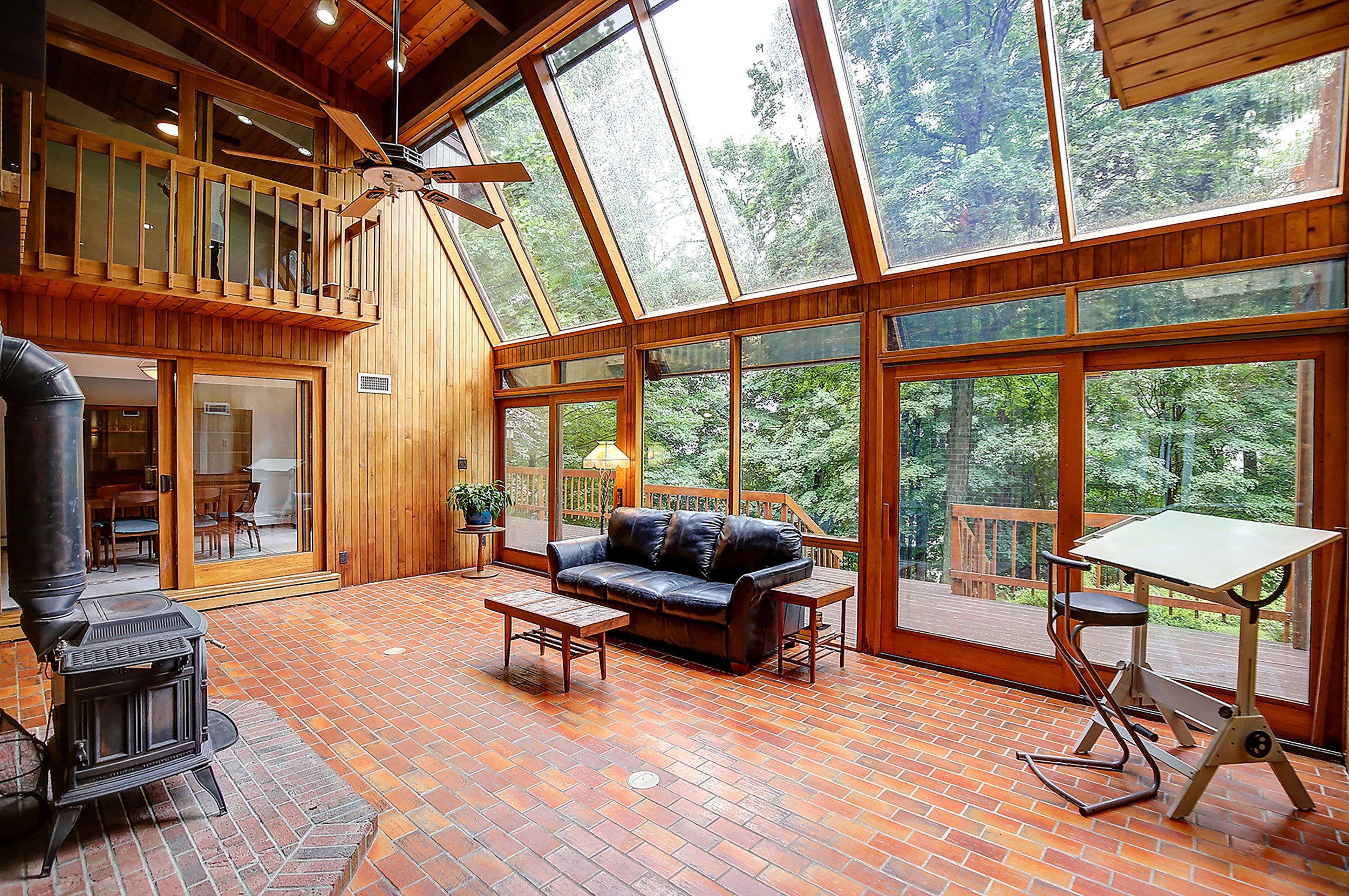 3 Live amongst the trees in the two story Great Room with wood stove and soaring windows IMG_6051_2_3.jpg