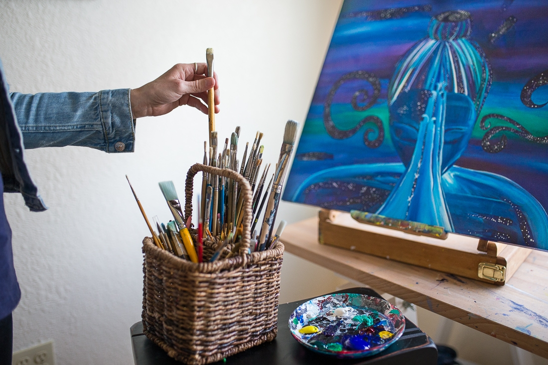So many choices! Here I am, choosing a brush in my studio.
