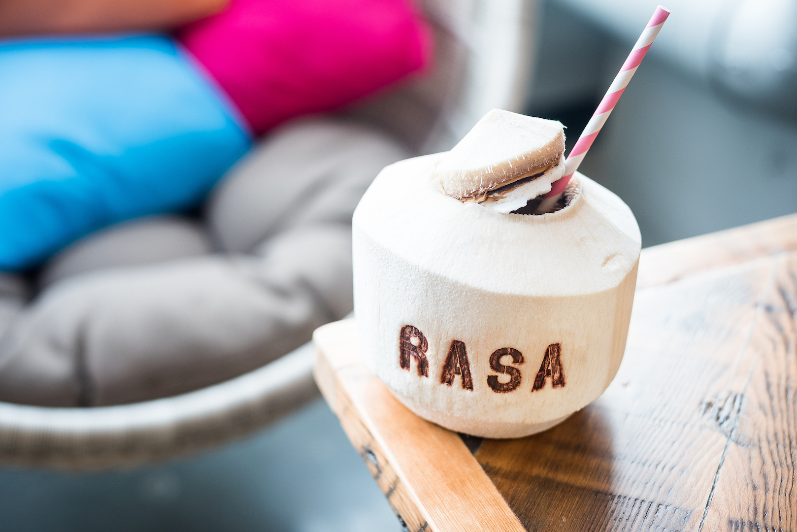 Rasa's fresh coconut is a refreshing companion to the vibrant food. (Photo by Rey Lopez)