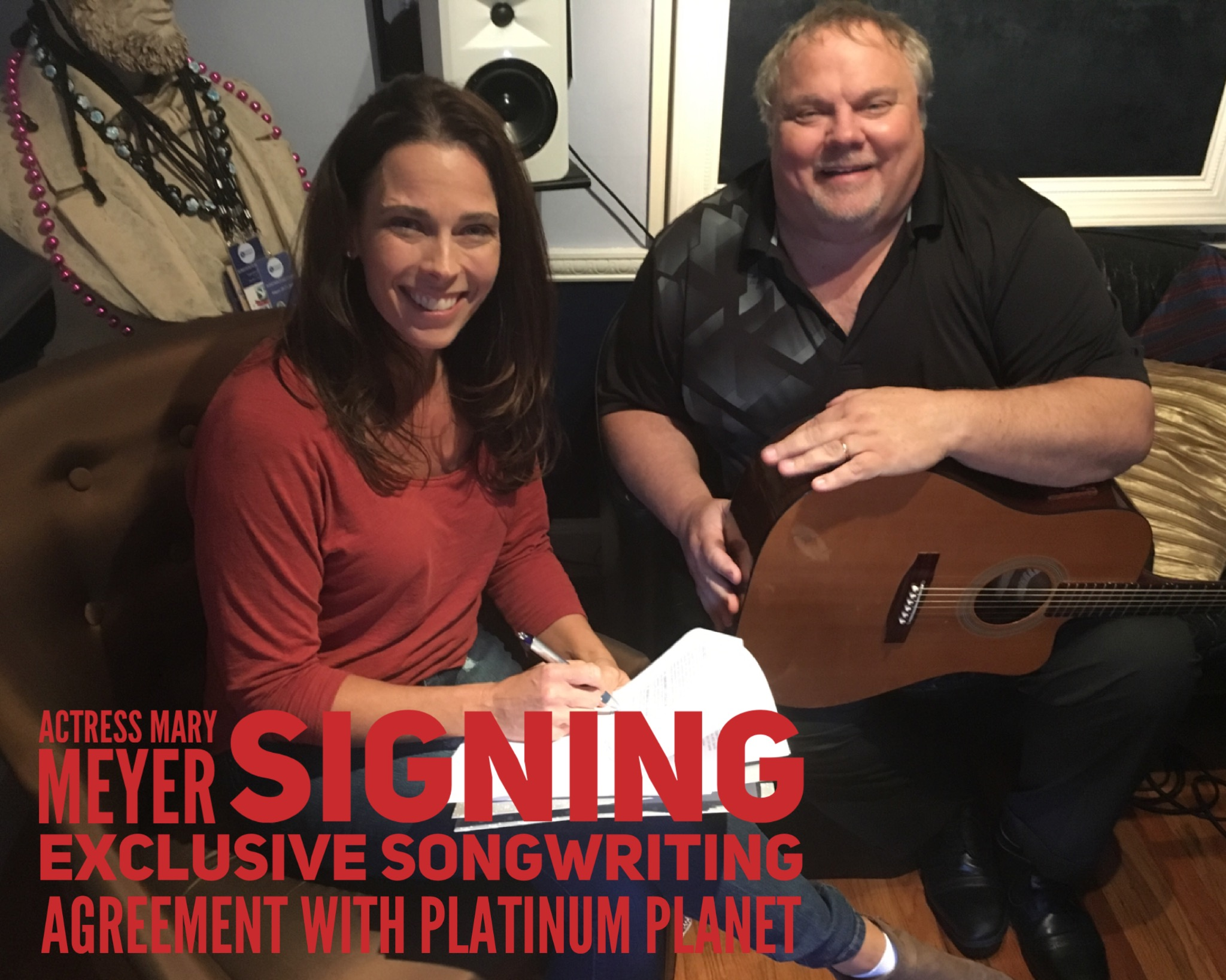 Signing with Songs for the Planet.JPG