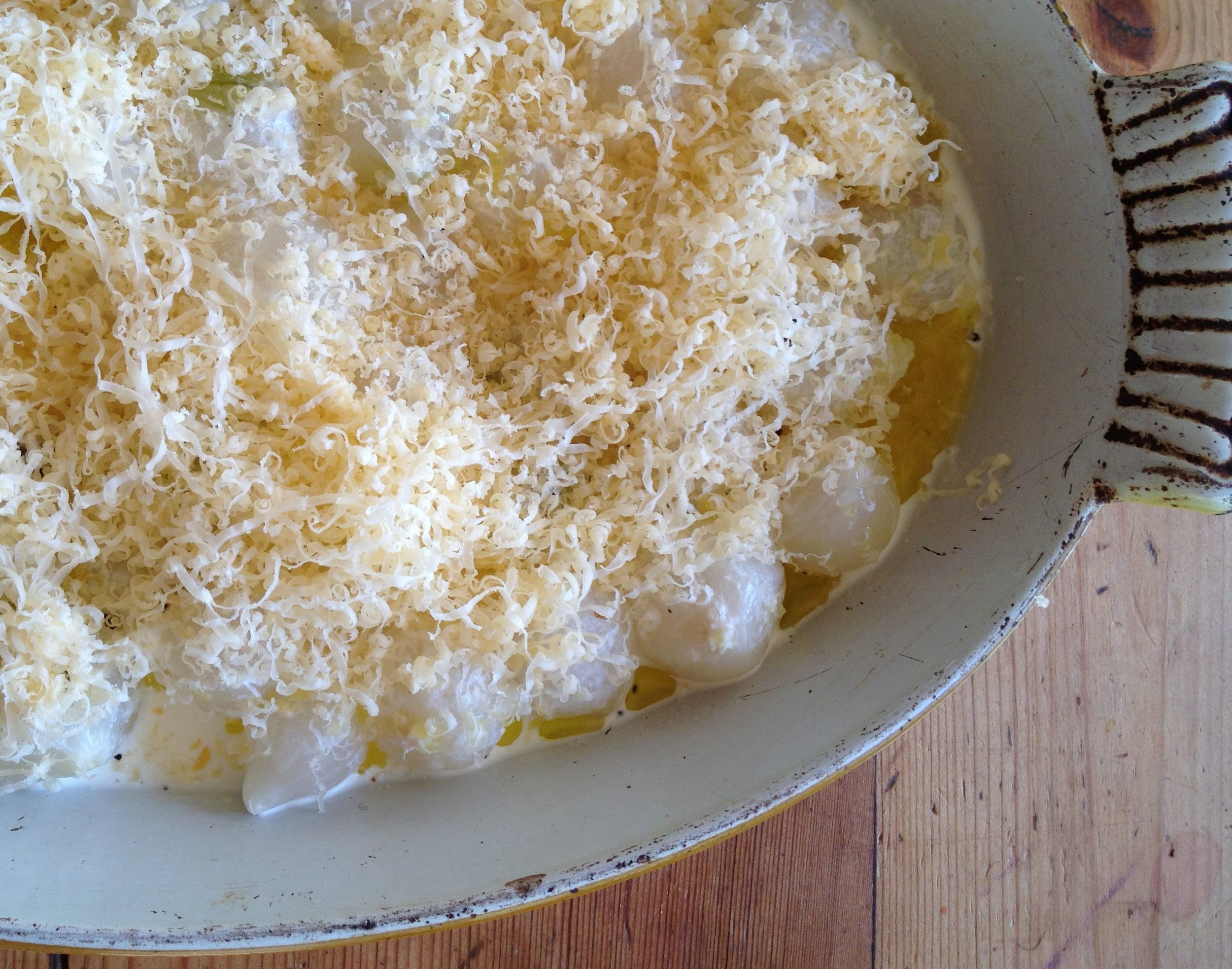 baked pearl onions with truffles and cheese