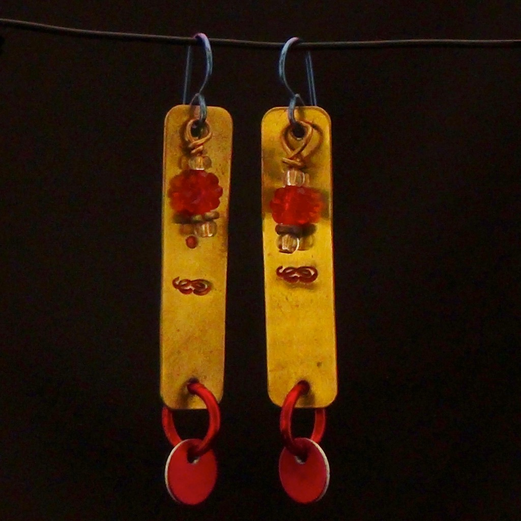 """The Best of Luck to You"", brass tags, glass, anodized aluminum on niobium ear wires"