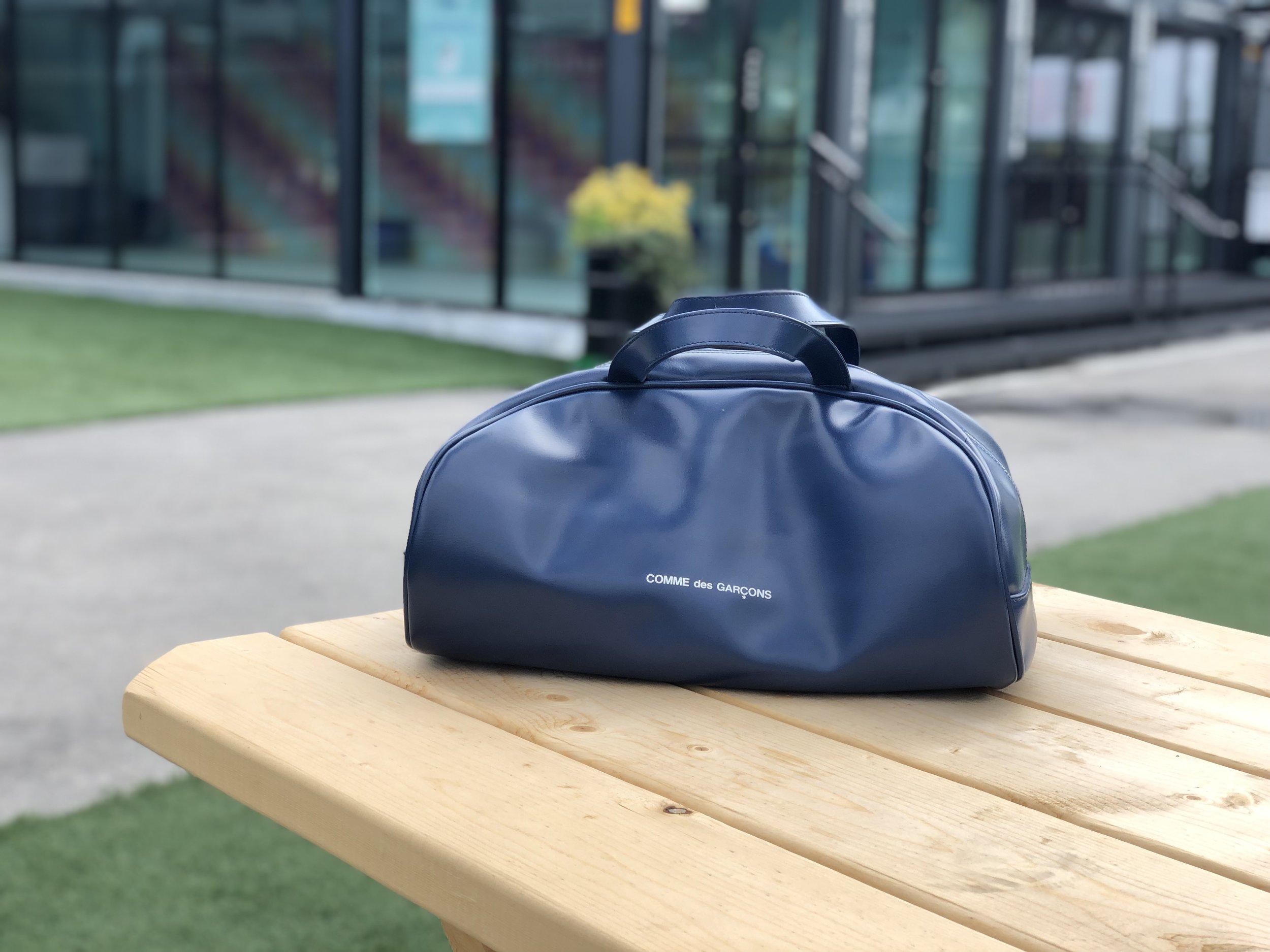FEATURED: COMME des GARÇONS Blue Bowling Bag Style Carry-On