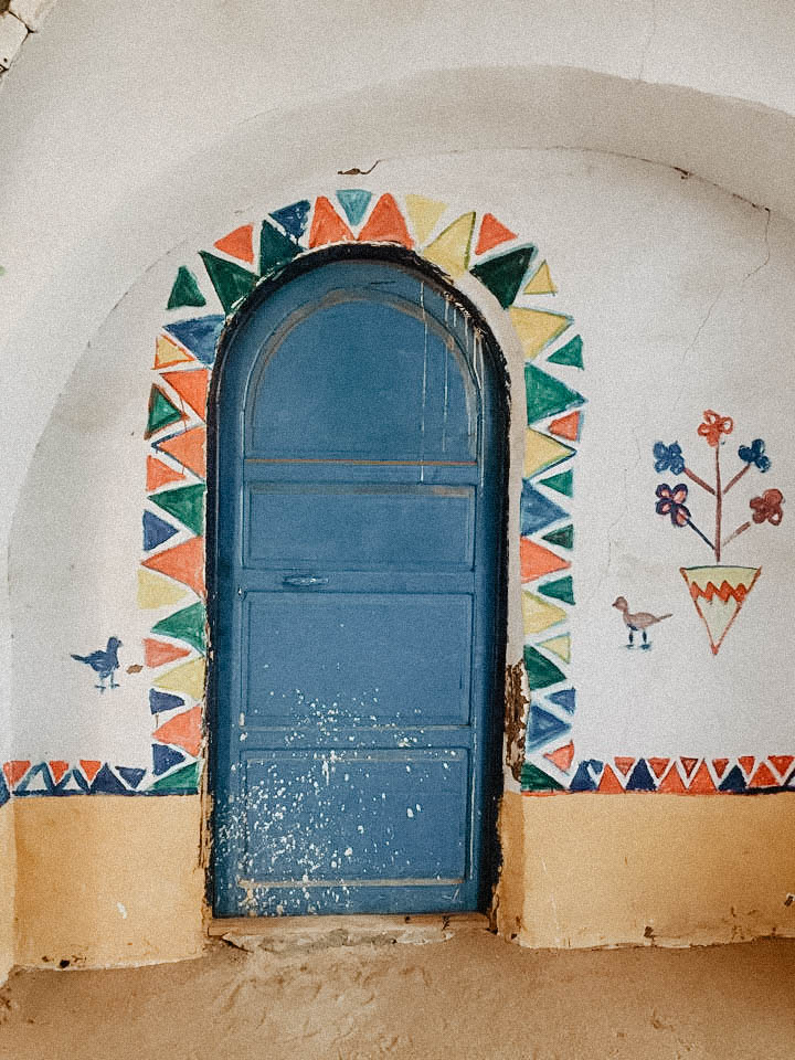 Another colorful entry way to one of the villagers homes.  -