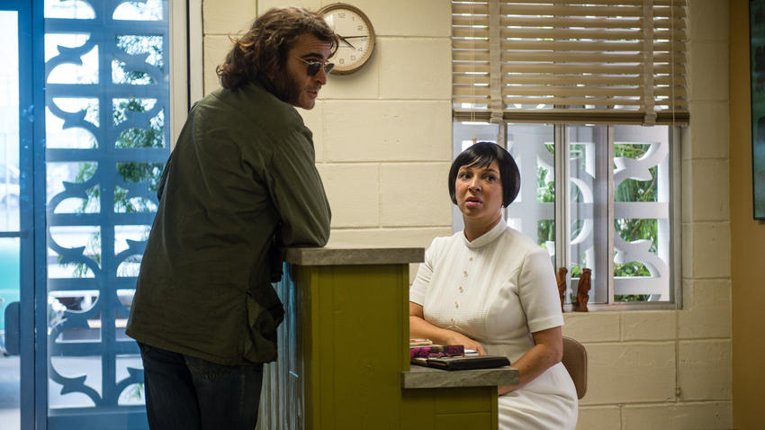 "Joaquin Phoenix, left, and Maya Rudolph in ""Inherent Vice."" (photo credit: Wilson Webb / Warner Bros)"