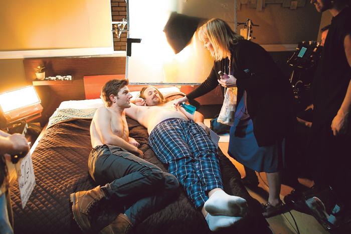 "SPOOF: Jake Szymanski has water applied to his belly in ""Rachel Bilson's Deleted Sex Scene"" with Adam Scott. Photo courtesy of Jay L. Clendenin"