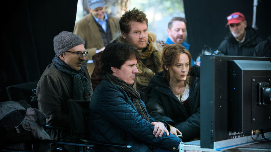 "Foreground from left: Producer John DeLuca, director Rob Marshall and actors James Corden and Emily Blunt on the set of ""Into the Woods."" (photo credit: Peter Mountain / Disney)"