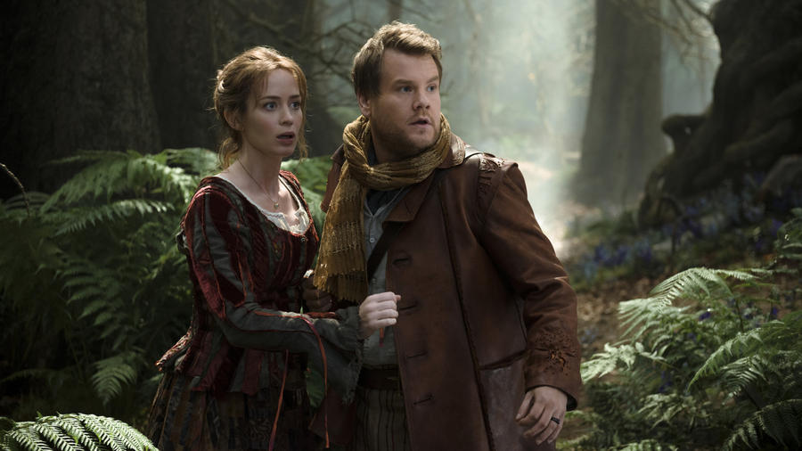 "James Corden and Emily Blunt as the Baker and Baker's Wife in ""Into the Woods."" (photo credit: Peter Mountain / Disney)"