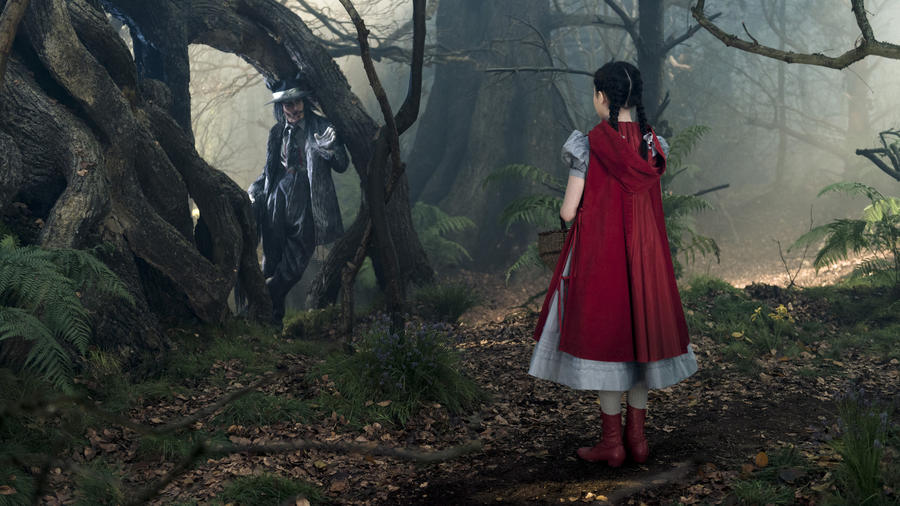 "Lilla Crawford's Little Red Riding Hood encounters Johnny Depp's Wolf in ""Into the Woods."" (photo credit: Peter Mountain / Disney)"
