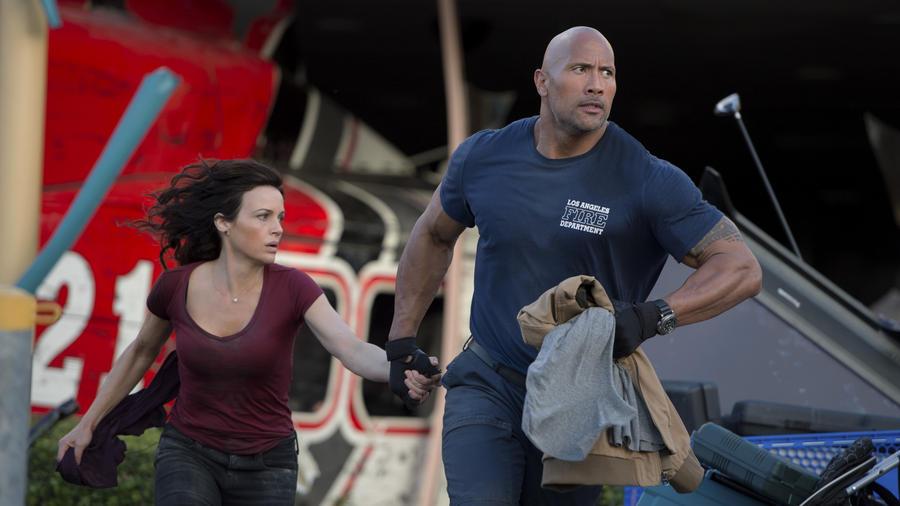 "Carla Gugino and Dwayne Johnson in ""San Andreas."" (Photo Credit: Jasin Boland / Warner Bros.)"