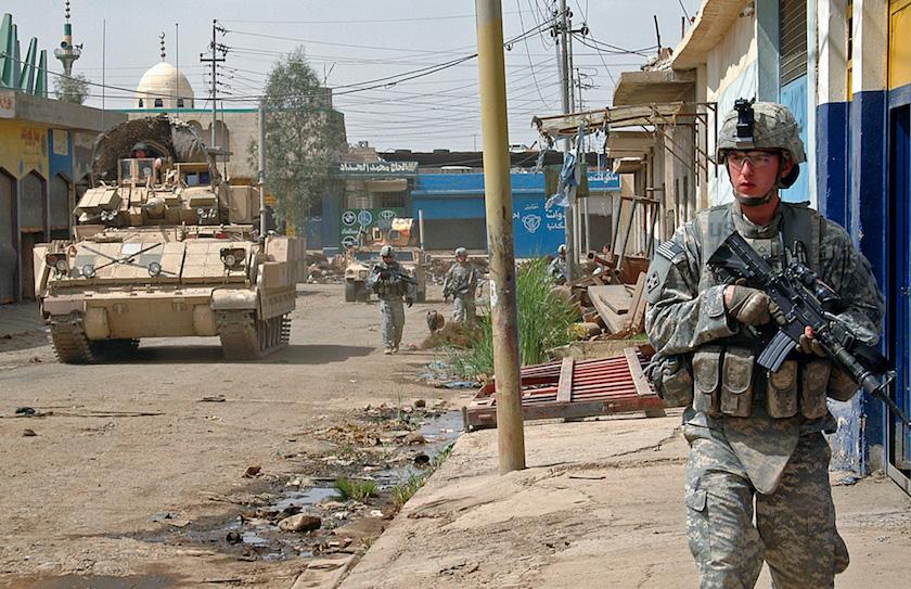 Pfc. Adam Devries patrols the streets of Mosul. DVIDS. Photo by Sgt. John Crosby.