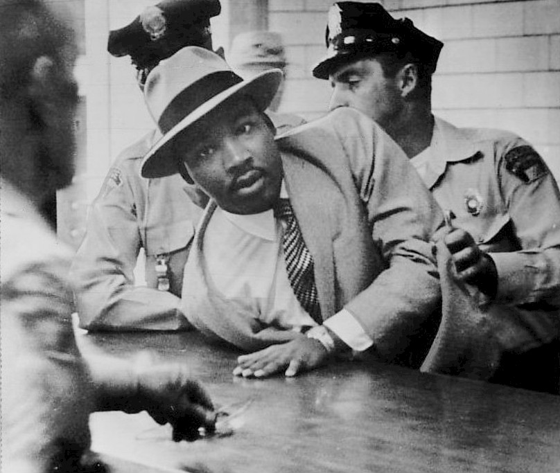 "Dr. Martin Luther King, Jr.  being arrested  in Montgomery, Alabama, for ""loitering"" in 1958."