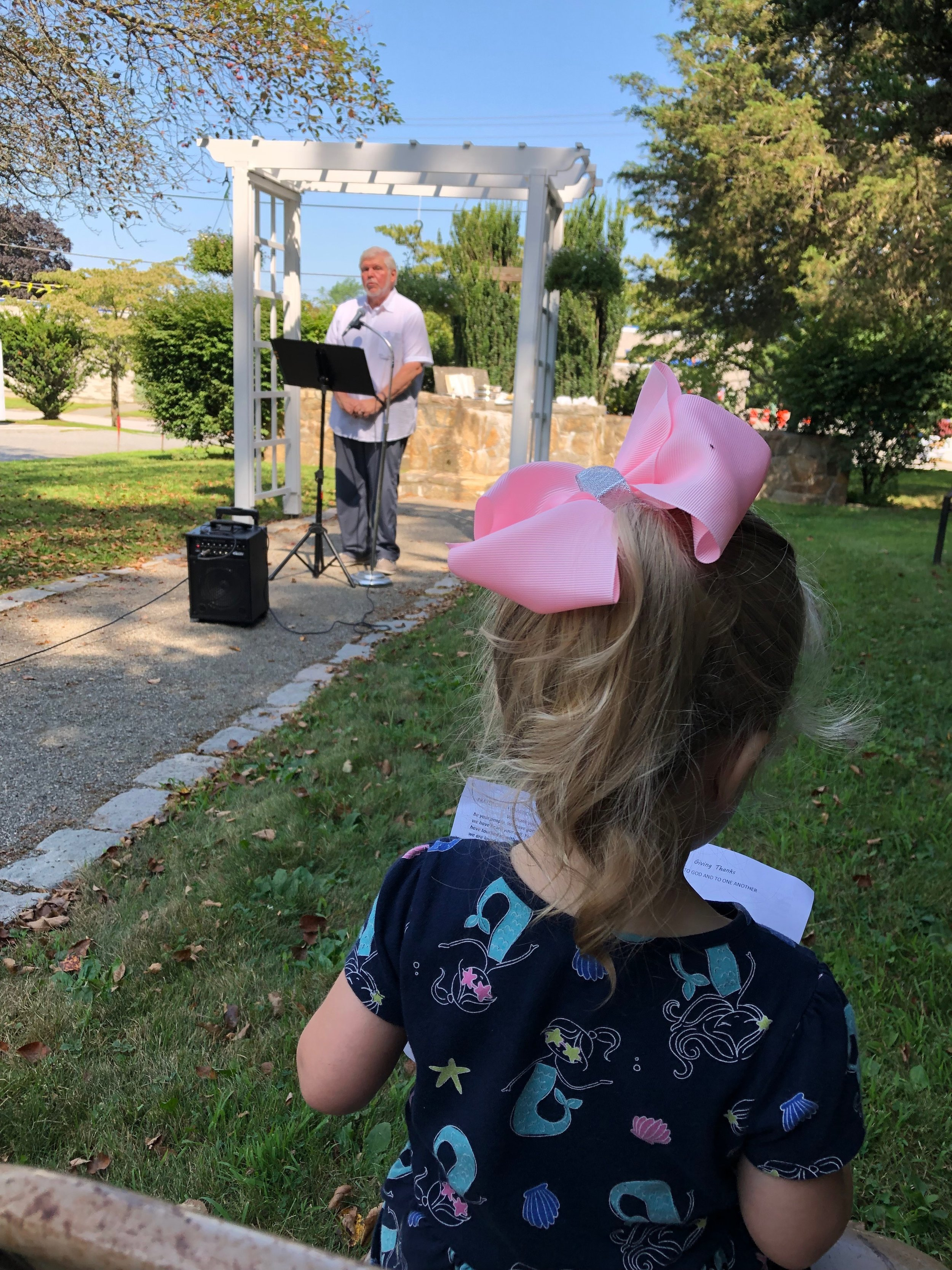 Callie Cranshaw enjoys the message given by Pastor Gene at the outdoor chapel on August 4th