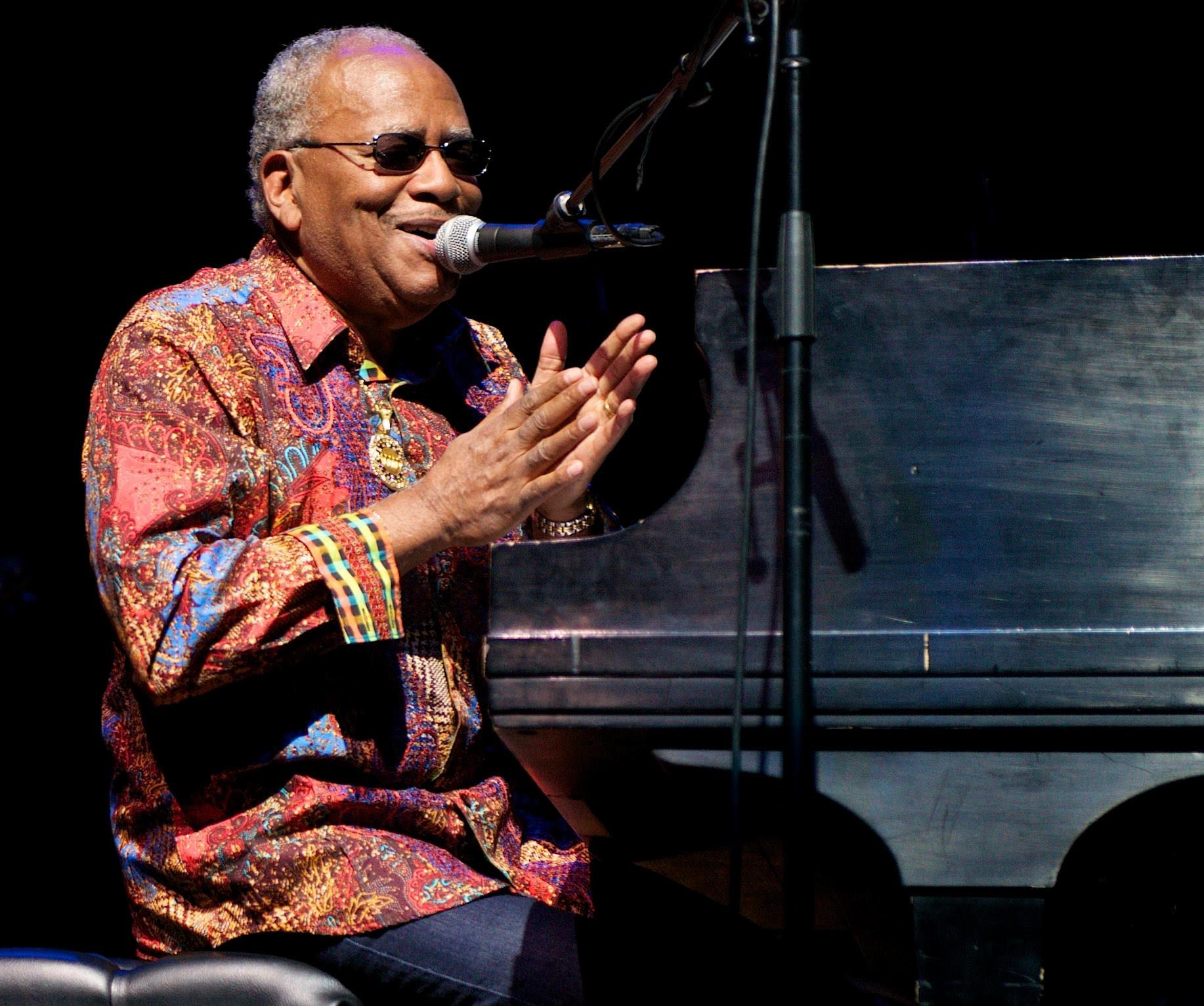 """Jazz pianist and Richmond native  Lonnie Liston Smith  spent much of the 1960s and early 1970s working with  Art Blakey  and  the Jazz Messengers , saxophonist  Pharoah Sanders  and the iconic  Miles Davis  before forming his own group, the Cosmic Echoes, in 1973. With his albums """"Astral Traveling,"""" """"Expansions"""" and """"Visions of a New World,"""" Smith has helped pioneer the Spiritual Jazz and Fusion genres. In the 1990s, he was hailed as one of the godfathers of the Acid Jazz movement, and he became a household name in Hip Hop when he collaborated with  Gang Starr 's Guru on his famed Jazzmatazz project. To this day, Smith's music are considered the gold standard of 1970s jazz and his songs cannot only be heard in countless Hip Hop hits in form of samples, but also in video games like """"Grand Theft Auto."""""""