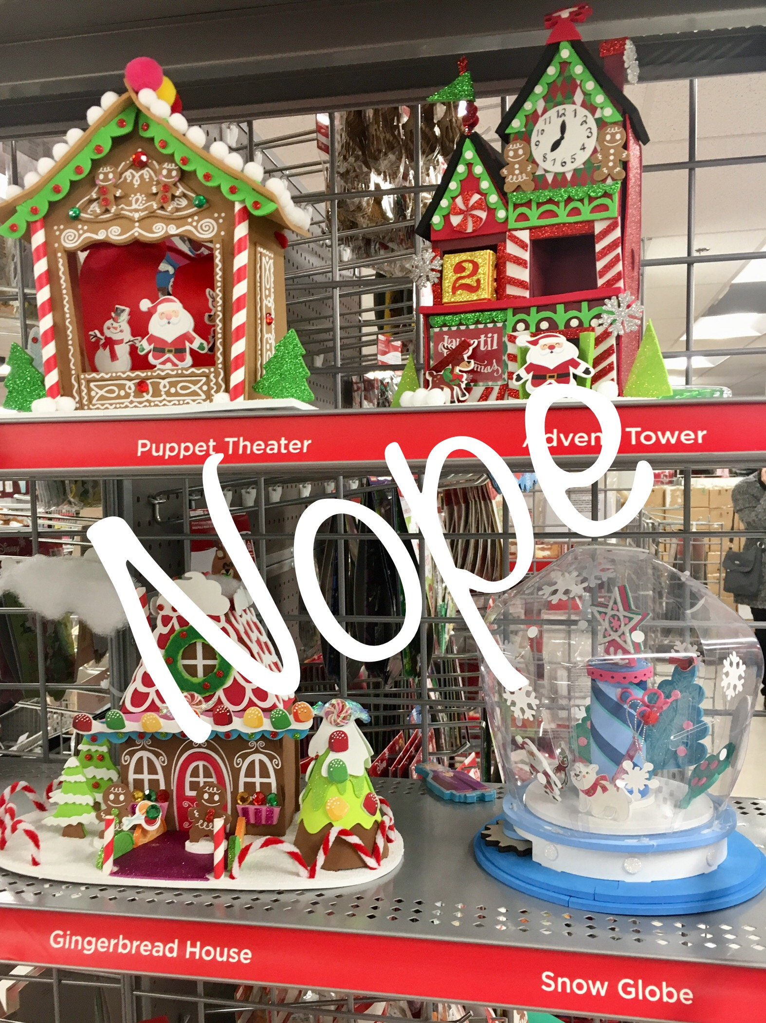 "Image: a store display of holiday craft kits with ""nope"" written across it."