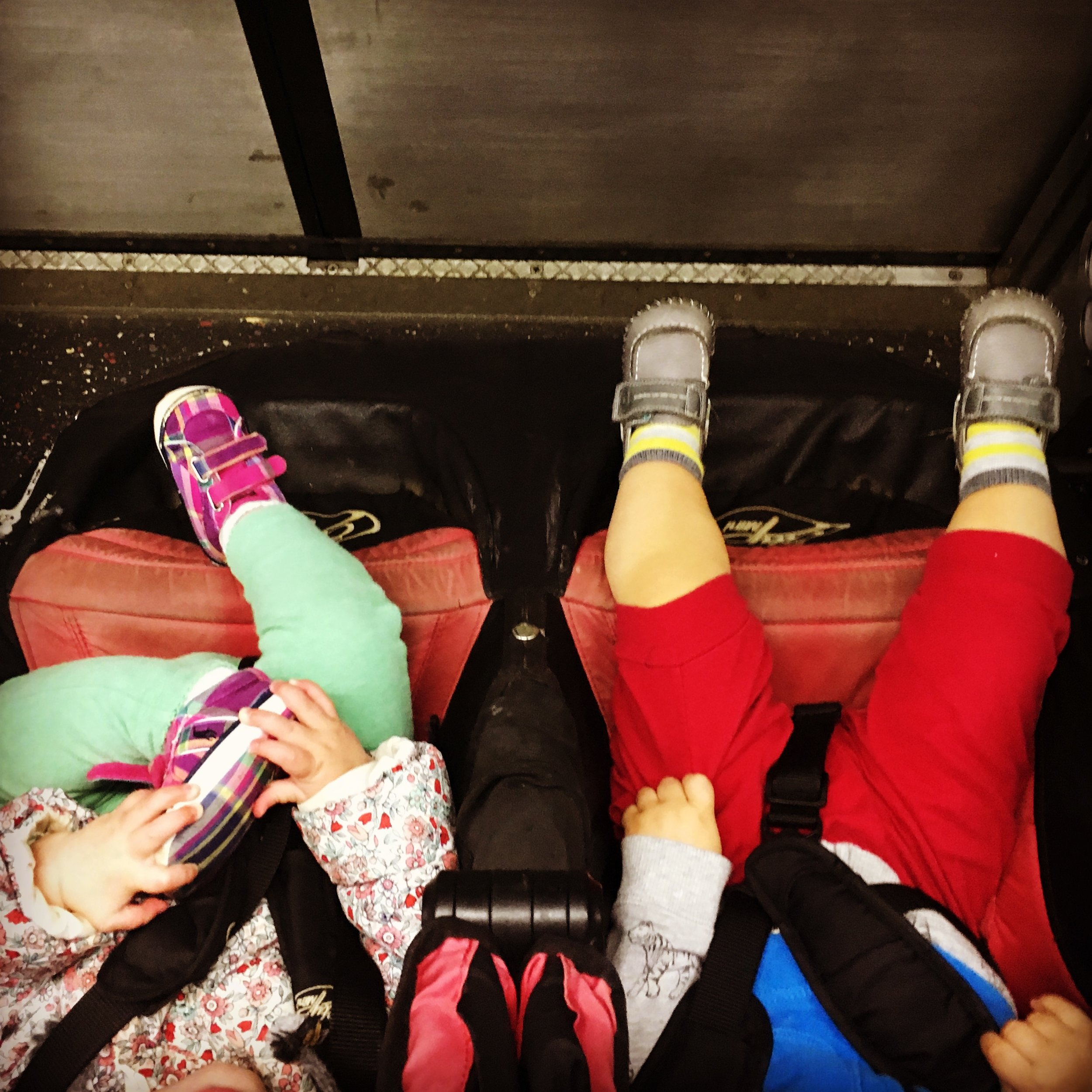 Image: Two toddlers in a double stroller in front of Metro train doors. Image copyright Elisabeth Caron