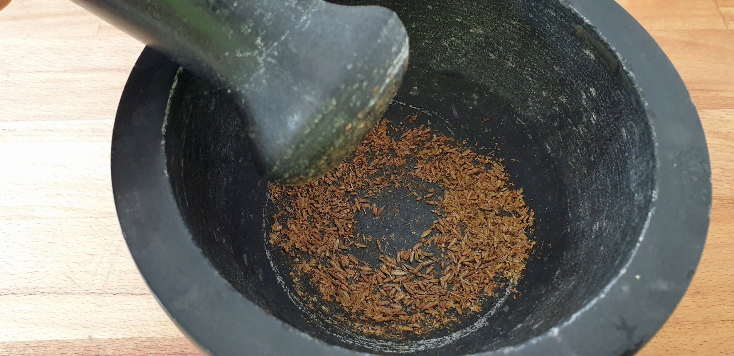Crush seeds in pestle and mortar.jpg