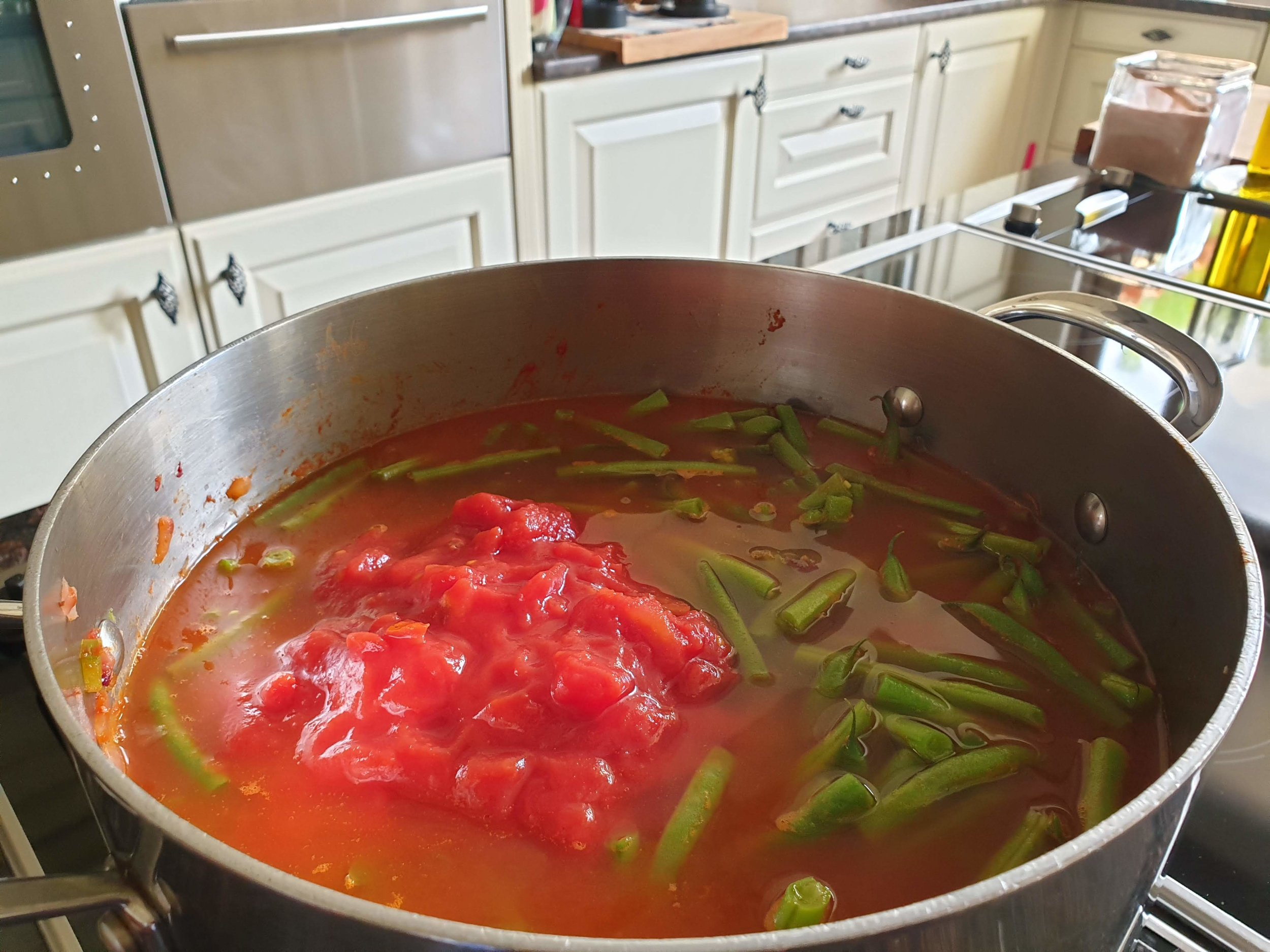 adding water and tinned tomato.jpg