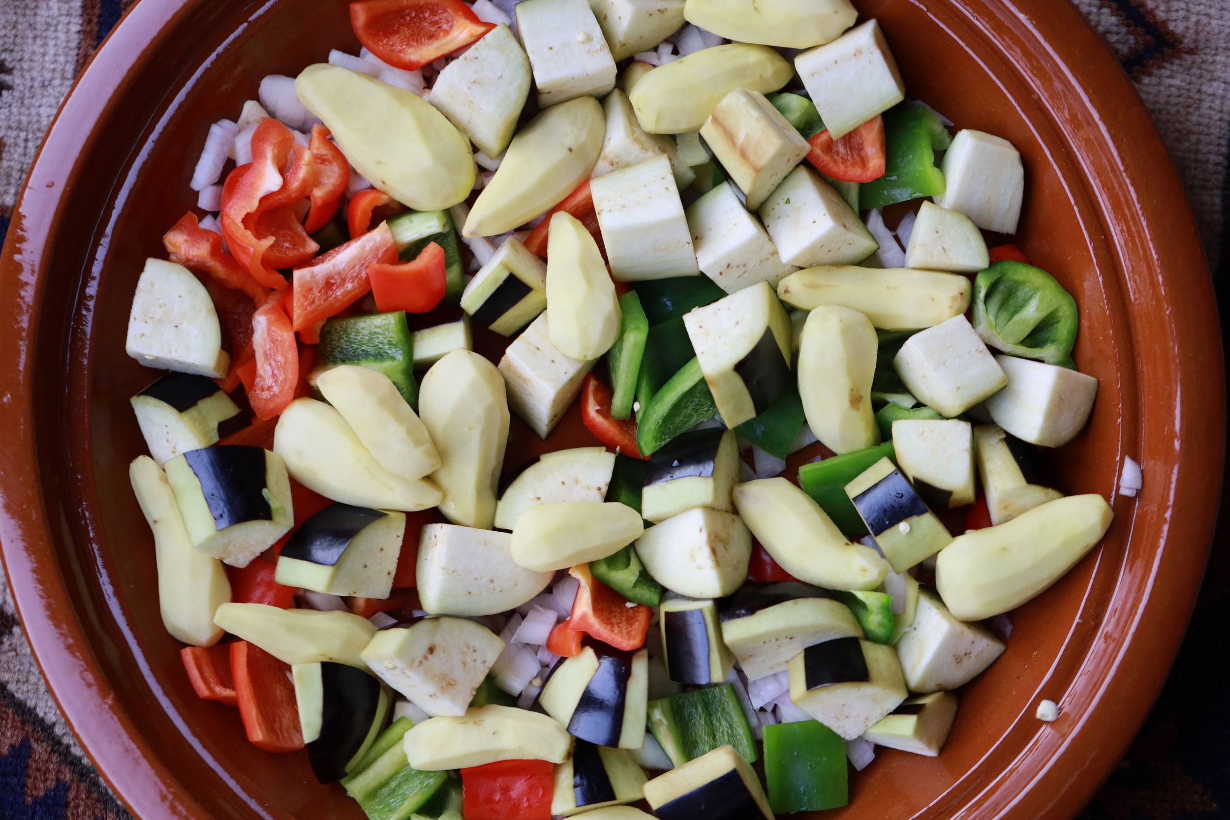 peel potato and add with veg to Tagine.JPG