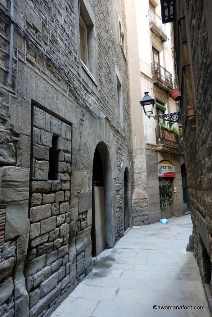 Gothic Quarter in Barcelona is the perfect place to wander around and admire the beautiful, ancient architecture and charm. #Barcelona #Spain #travel #history #introvert awomanafoot.com