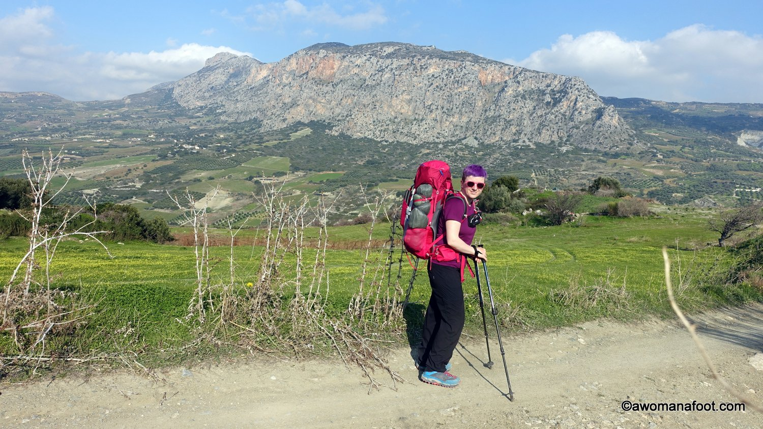 Hiking along the E4 on Crete - in the Iraklio/Heraklion district. Walking solo through charming villages, olive groves, and vineyards - and wild camping under olive branches. From Ano Asites, through Profiti Ilias to just before Archanes. Awomanafoot.com #hiking #E4trail #Crete #solo #FemaleHikers #WomenHiking #WildCamping #Trail   What to do on Crete   HIking on Crete   Visit Crete   Adventures on Crete  