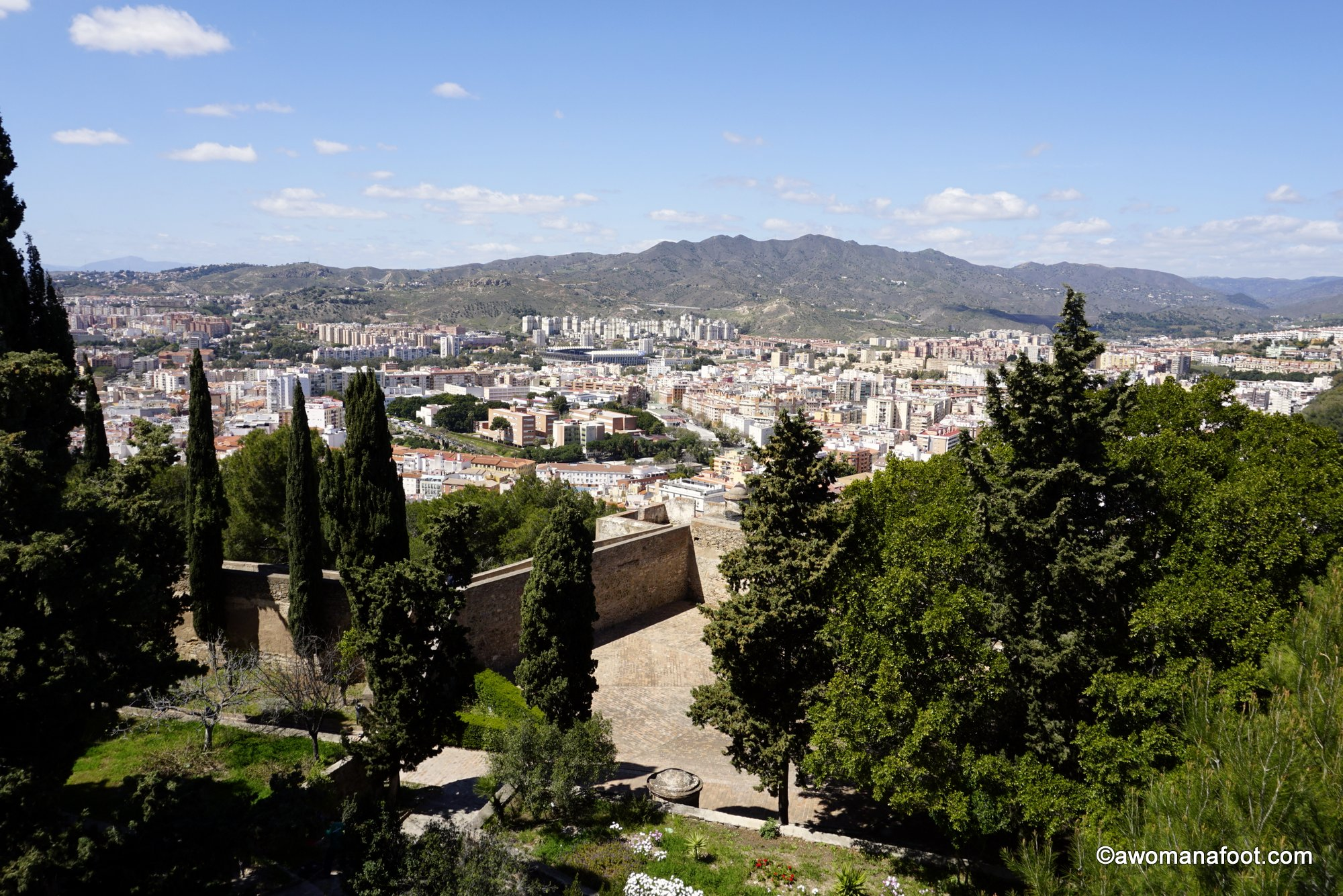 Málaga's history spans almost three millennia. We can still see marvelous signs of the old history - Roman theater, Medieval Muslim #Alcazaba and #Gibralfaro - military base from the times of the Catholic kings. See why those places are a must for any visitor to Málaga @ AWOMANAFOOT.COM! What to see in #Málaga | Best #travel #destinations in Spain | #Spain for history buffs | #Must-see in Málaga.