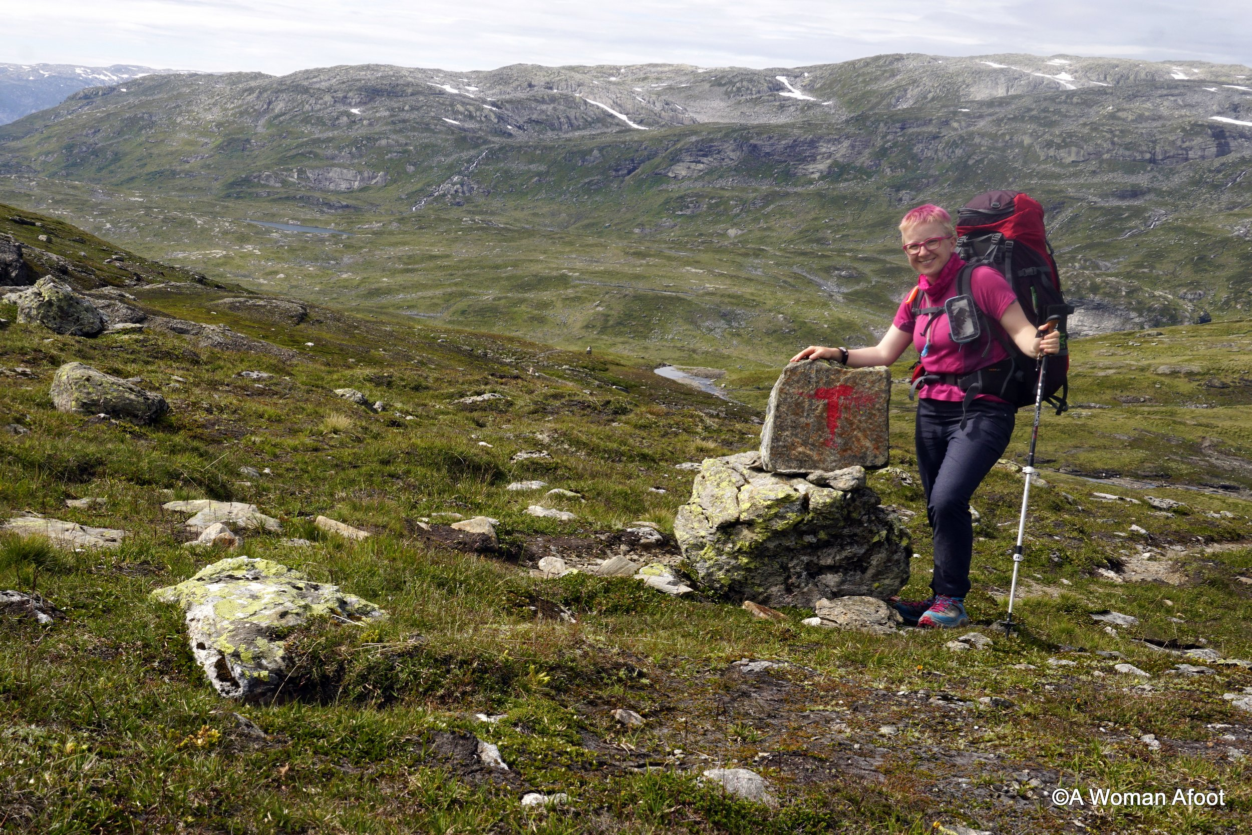 Setting out from the adventure capitol in Voss, I take you on a fantastic solo hike through the Norwegian mountains. From Voss and Bjergane to Solrenningen, this area has it all: snow-covered peaks, waterfalls, crystal-clear lakes, and charming mountain shelters - learn more @ awomanafoot.com! Hiking solo in Norway | Hiking destinations in Europe | Great trails in Scandinavia | Female solo hiking in Europe | Solo travel destinations | Wild camping in Norway | Norwegian mountains | What to do in Norway | #Hiking #Camping #Norway #Trails #SoloHiking #FemaleSoloTravel #Adventure
