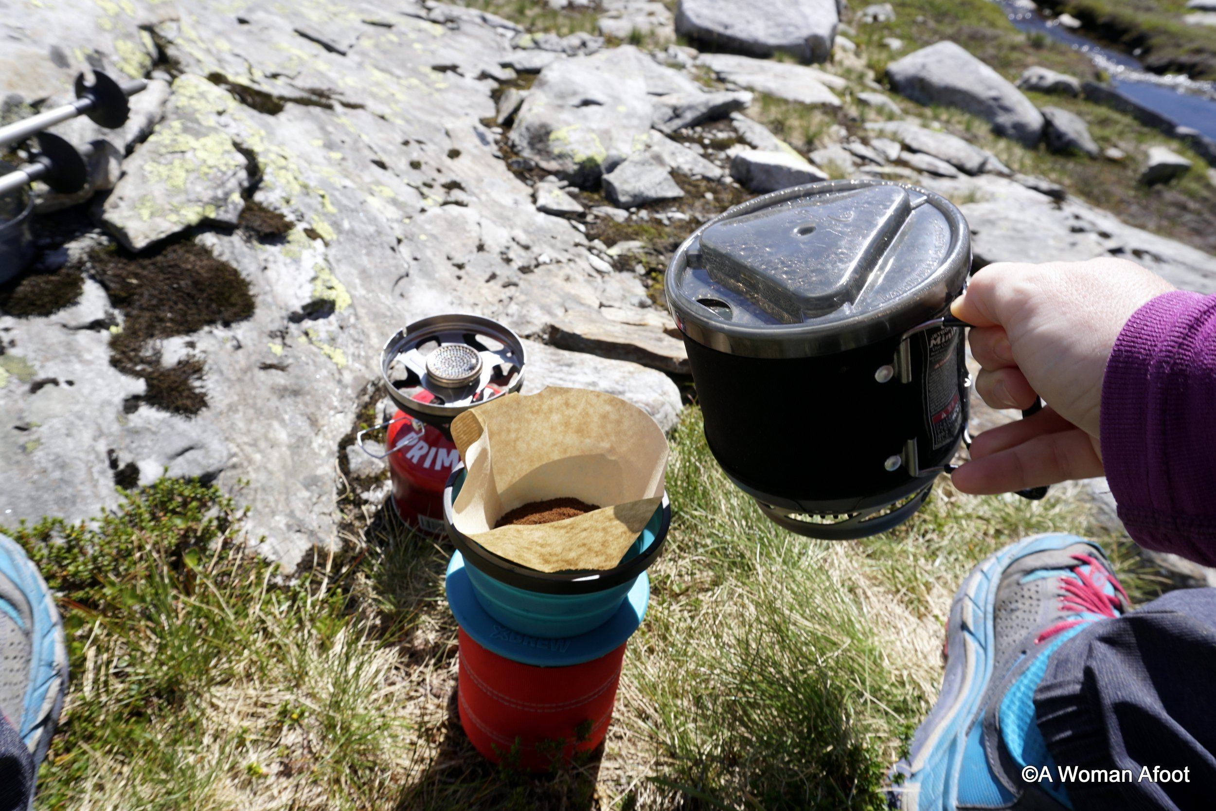 Aluminum or Steel? Or maybe titanium? A whole set or individual pots? Learn all you need about the various camping cookware to choose what you need! A high-quality advice for hikers, backpackers, and car campers. awomanafoot.com #camping | #hiking | #camp kitchen | camping dishes | backpacking | What to pack for camping? | What Camping gear do I need? |