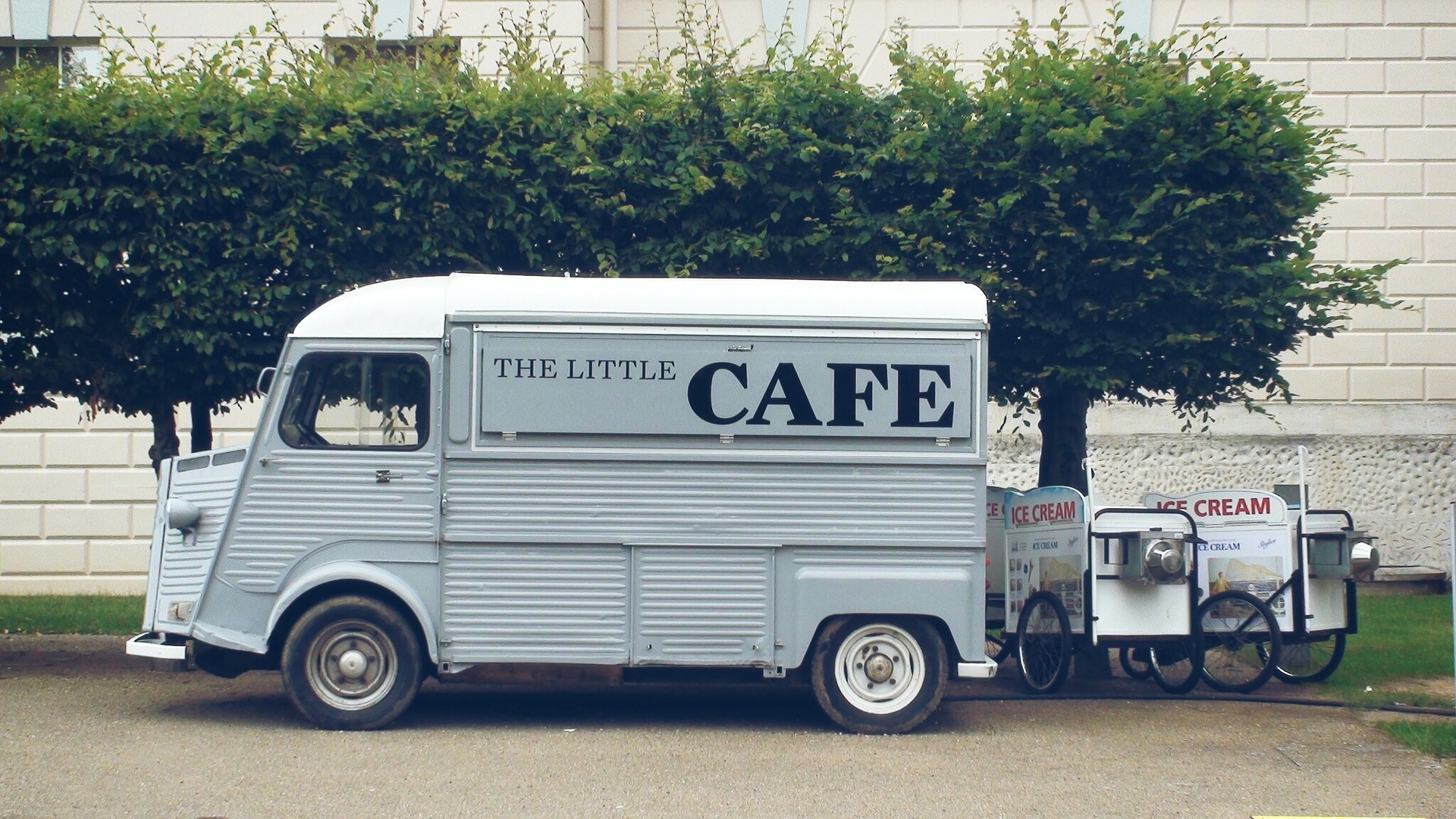 """Small food truck called """"The Little Cafe."""""""