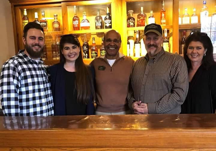"""Some of the Administration of Whiskey University posing with   Bourbon Hall of Famer Freddie Johnson   at a tasting after a Tour at the  Buffalo Trace Distillery . Pictured above are   Professor Nicolas Goodall, Web Master Alexandra """"Lexie"""" Duncan  , Buffalo Trace's Freddie Johnson, Founder of Whiskey University    Professor Colonel Craig Duncan   and   Administrator Melissa Duncan."""