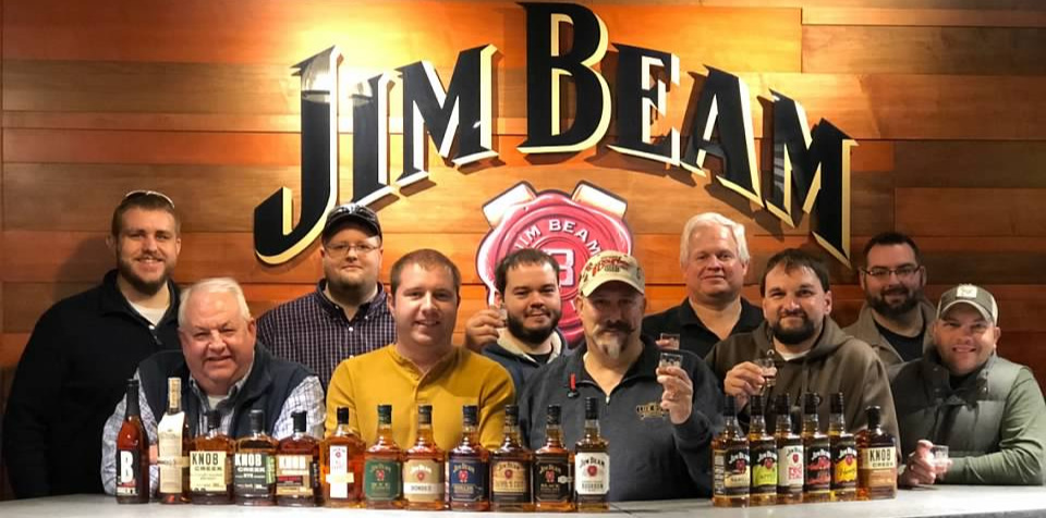 Some of the Staff of Whiskey University in the tasting room at the Jim Beam Distillery in Clermont, Kentucky. Pictured above (front row from left to right);   Professor Lt. Colonel Dale Robinson, Professor Lt. Colonel Christopher Hart, Professor Colonel Craig Duncan, Professor Lt. Colonel Carl Ingrum,   guest. Back row (l-to-r);   Dakota Mercer, Casey Williams, Bobby Graham, Professor Lt. Colonel Ross Osborne   and   Professor Lt. Colonel Christopher Yow.
