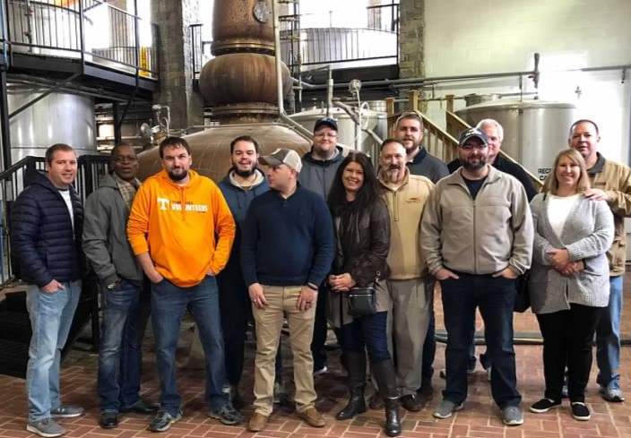 Some of the   Staff of Whiskey University   in from of the Pot Still at the   Willett Distillery.   Pictured above from left to right   Professor Lt. Colonel Christopher Hart, Devere Walker, Professor Lt. Colonel Carl Ingrum, Bobby Graham,   guest,   Casey Williams, Administrator Melissa Duncan, Professor Colonel Craig Duncan, Dakota Mercer, Professor Lt. Colonel Christopher Yow, Professor Lt. Colonel Ross Osborne,   Monya Hunter and   John Hunter.
