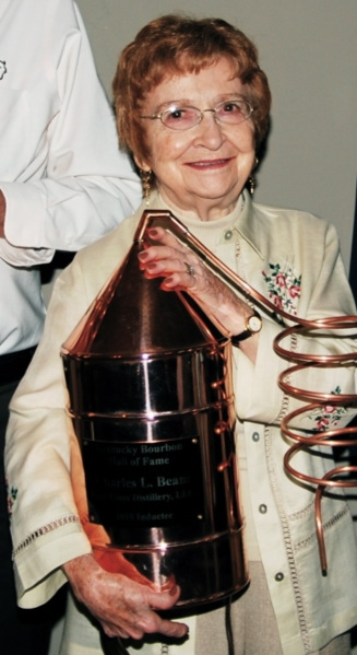 Mary Lee Kuhn Beam   accepts the honor and Trophy for her husband   Charles L. Beam   to be inducted into the Bourbon Hall of Fame in 2010. Photo provided by the Kentucky Bourbon Hall of Fame