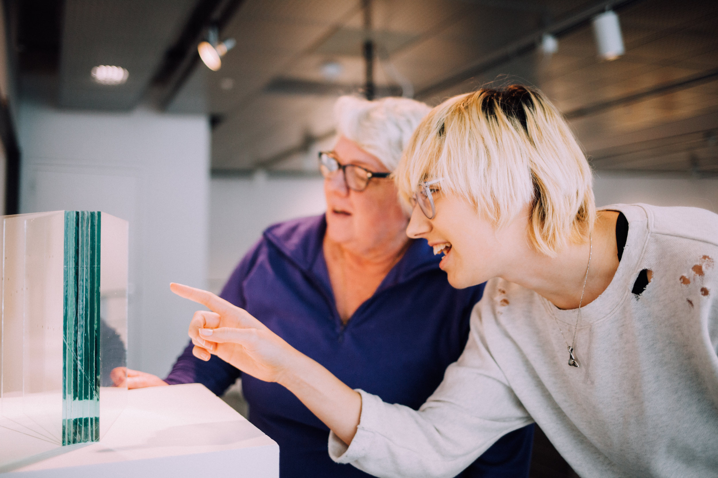 Two gallery guests looking at artwork together.