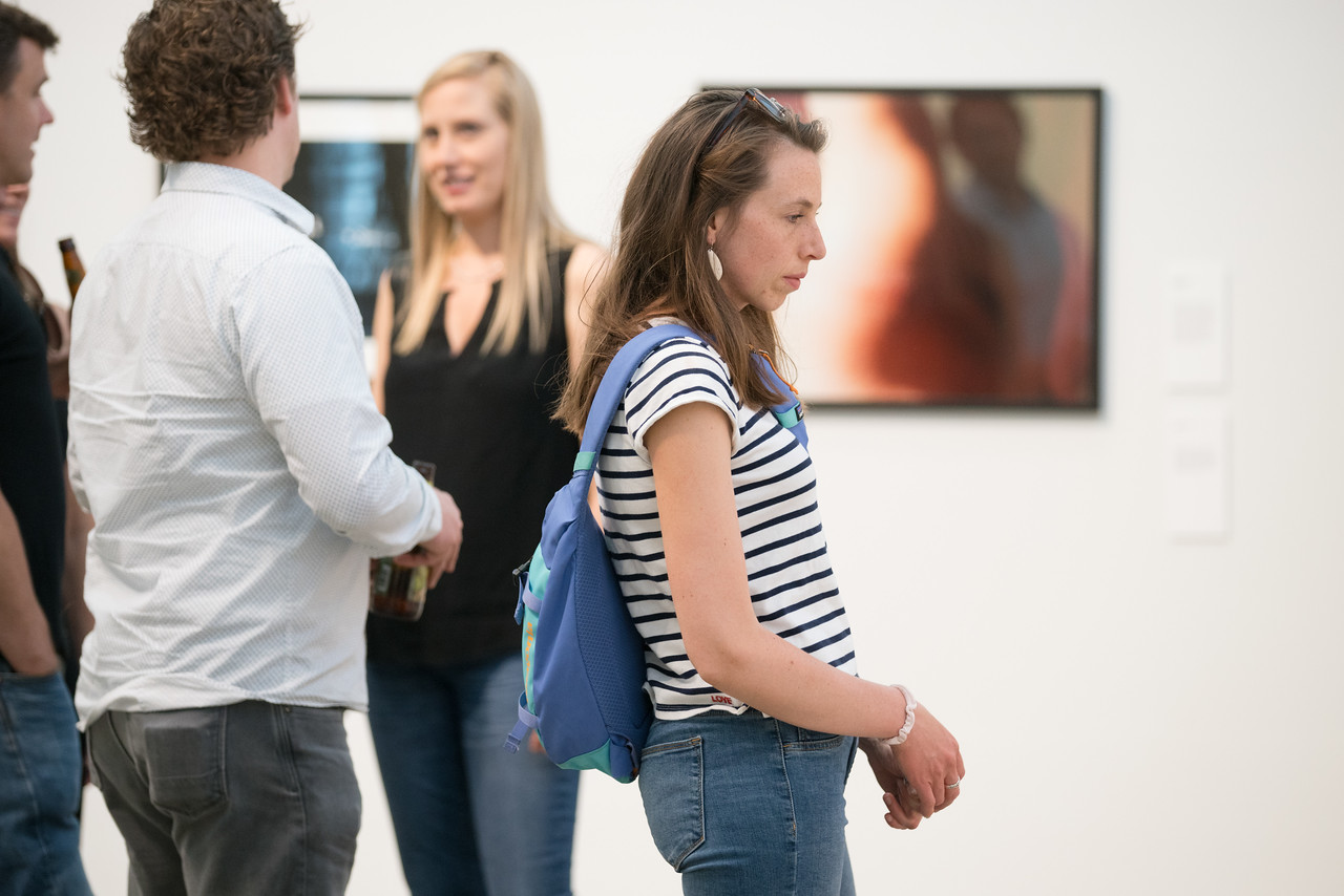 Photo of guests looking at artwork