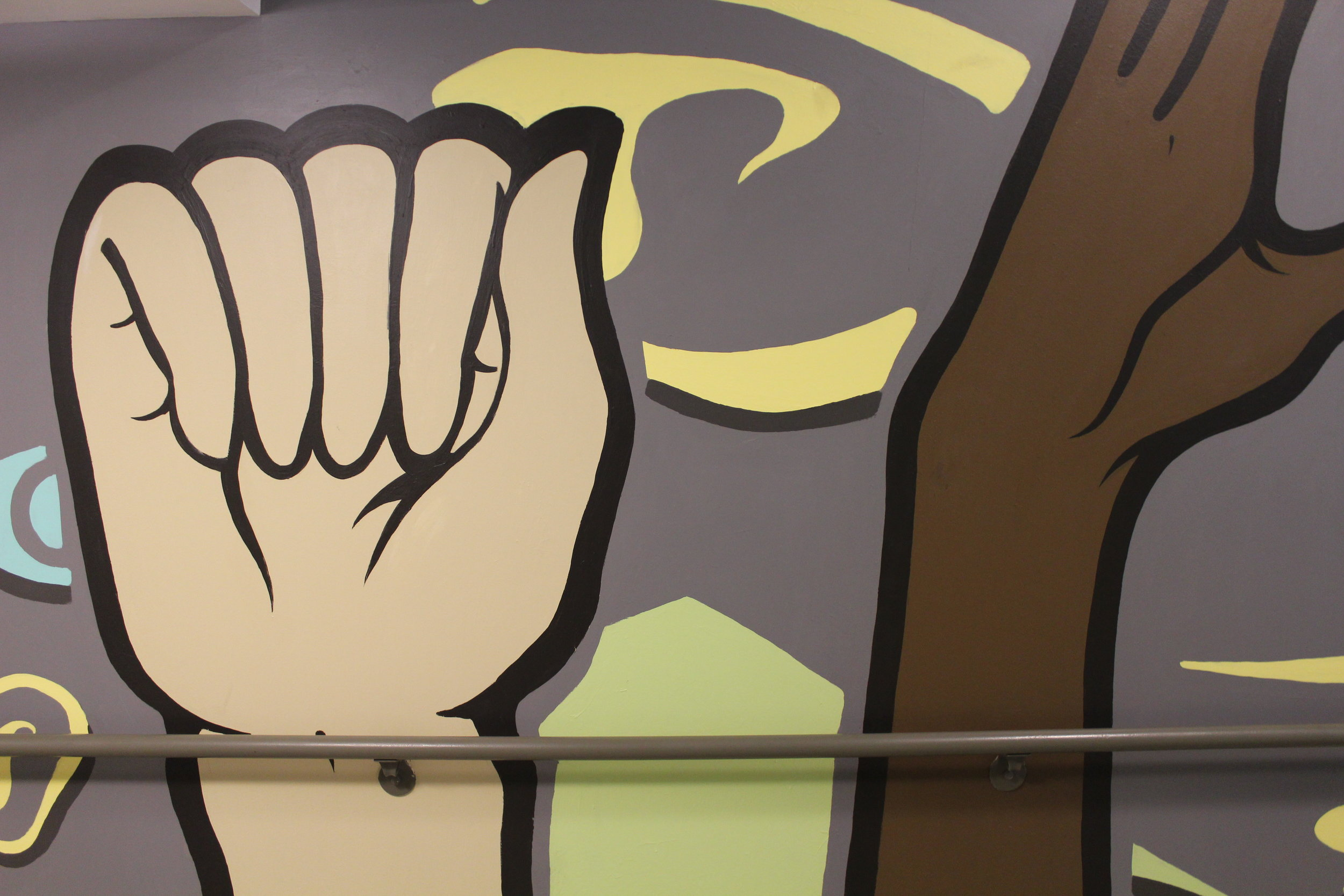 Hand sign detail of Artworks mural