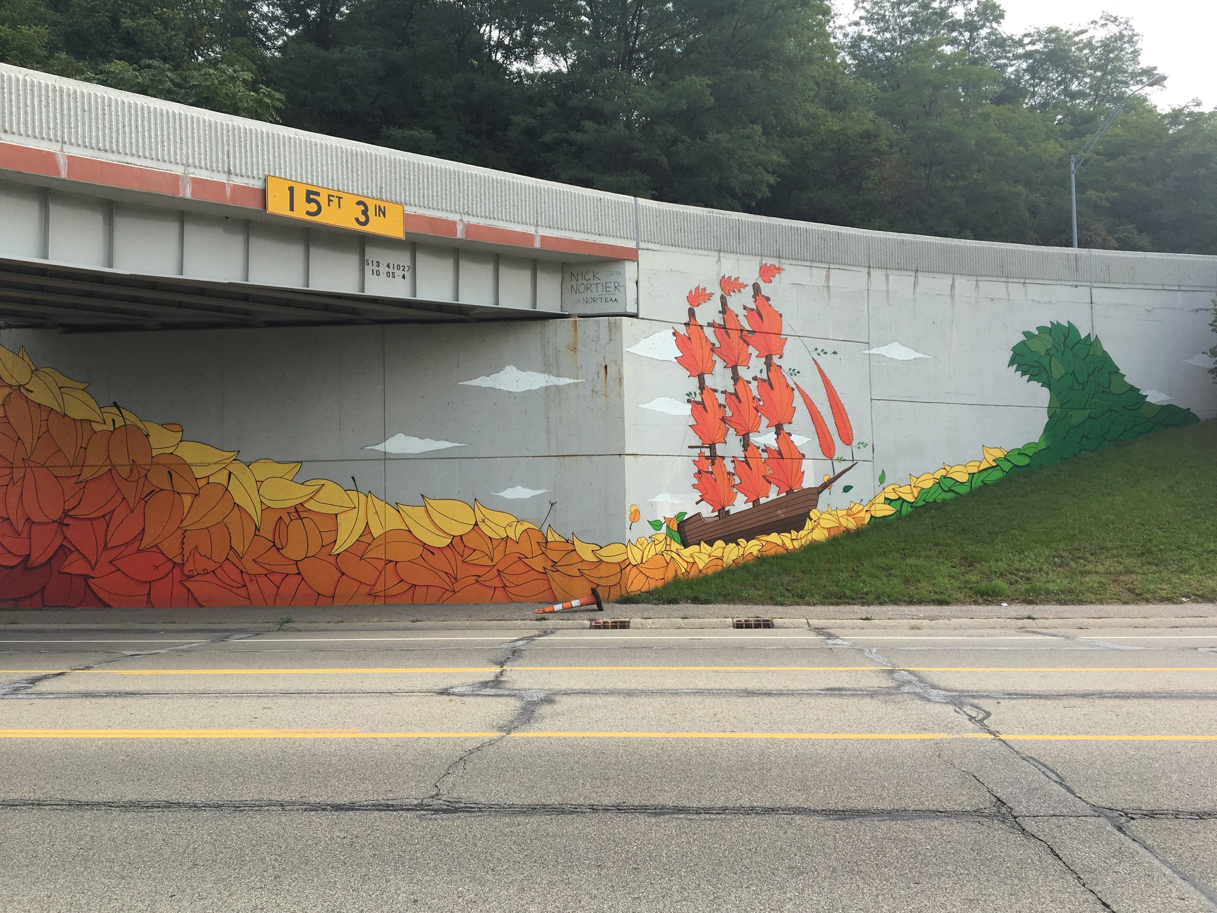 Nature inspired retaining wall mural on I-196
