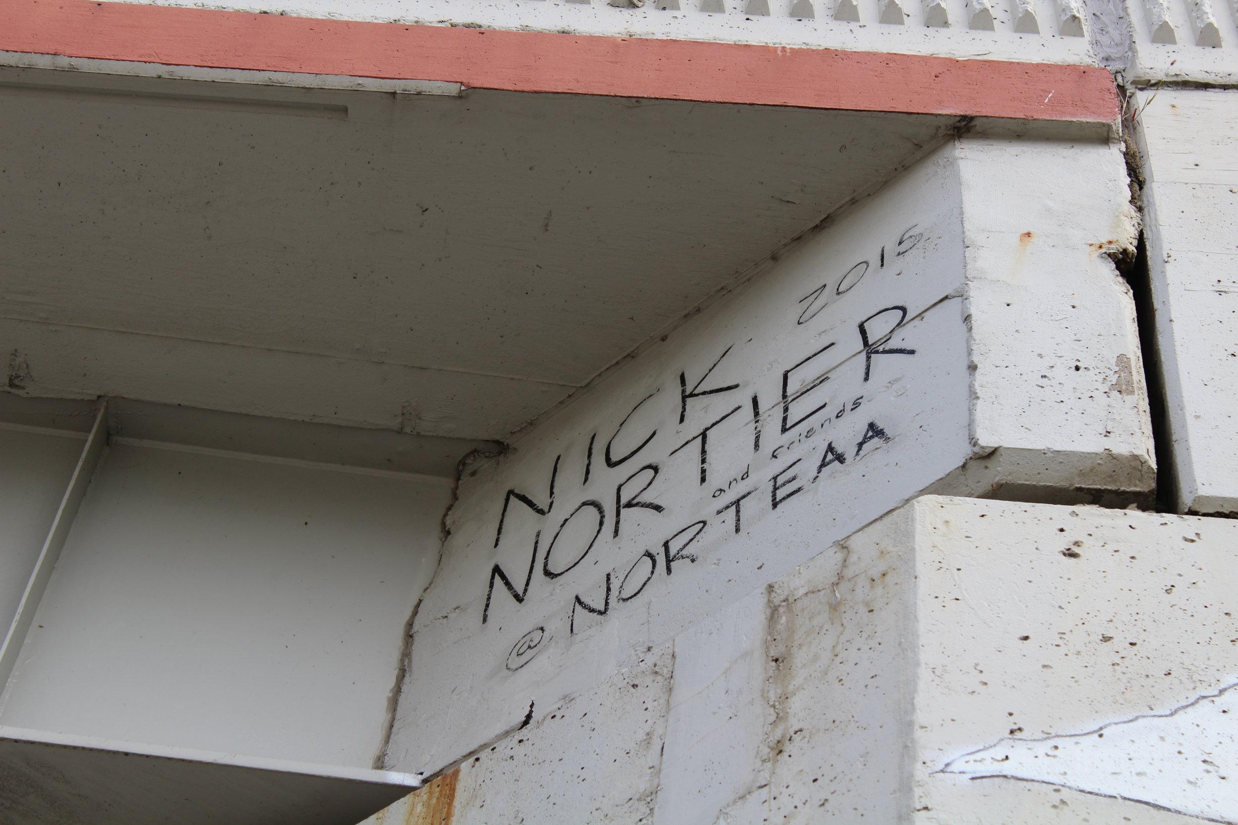Signature of artist above mural