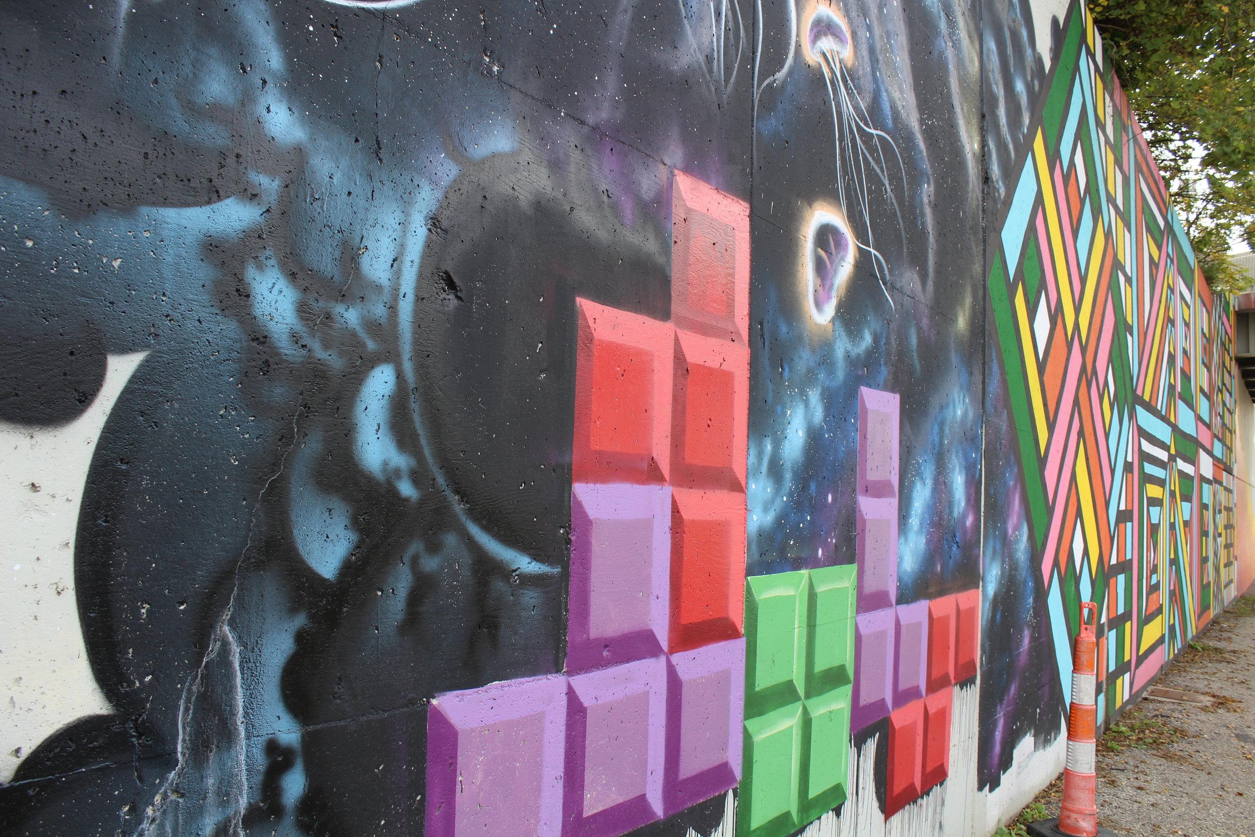 Tetris detail of mural on retaining wall of I-196
