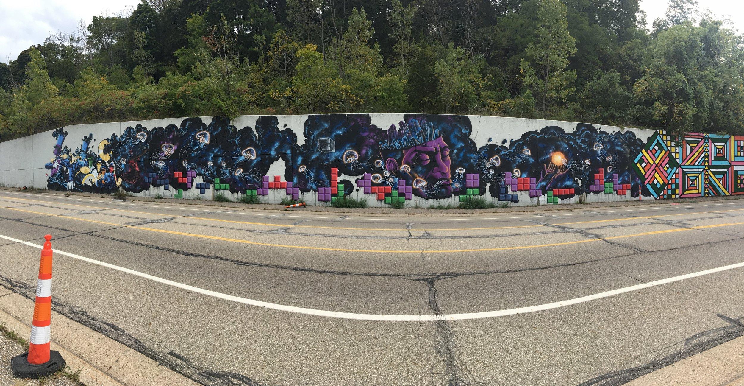 Eberheart retaining wall mural on I-196 (full view)
