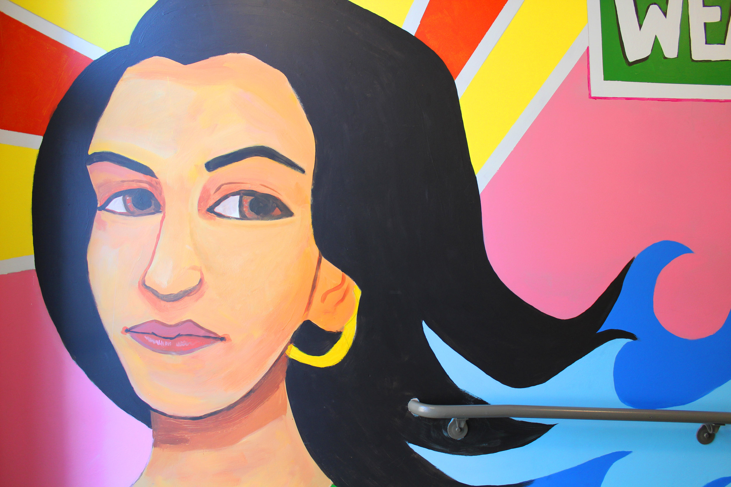 Detail of a Latin@ woman's face on Gallery parking ramp mural