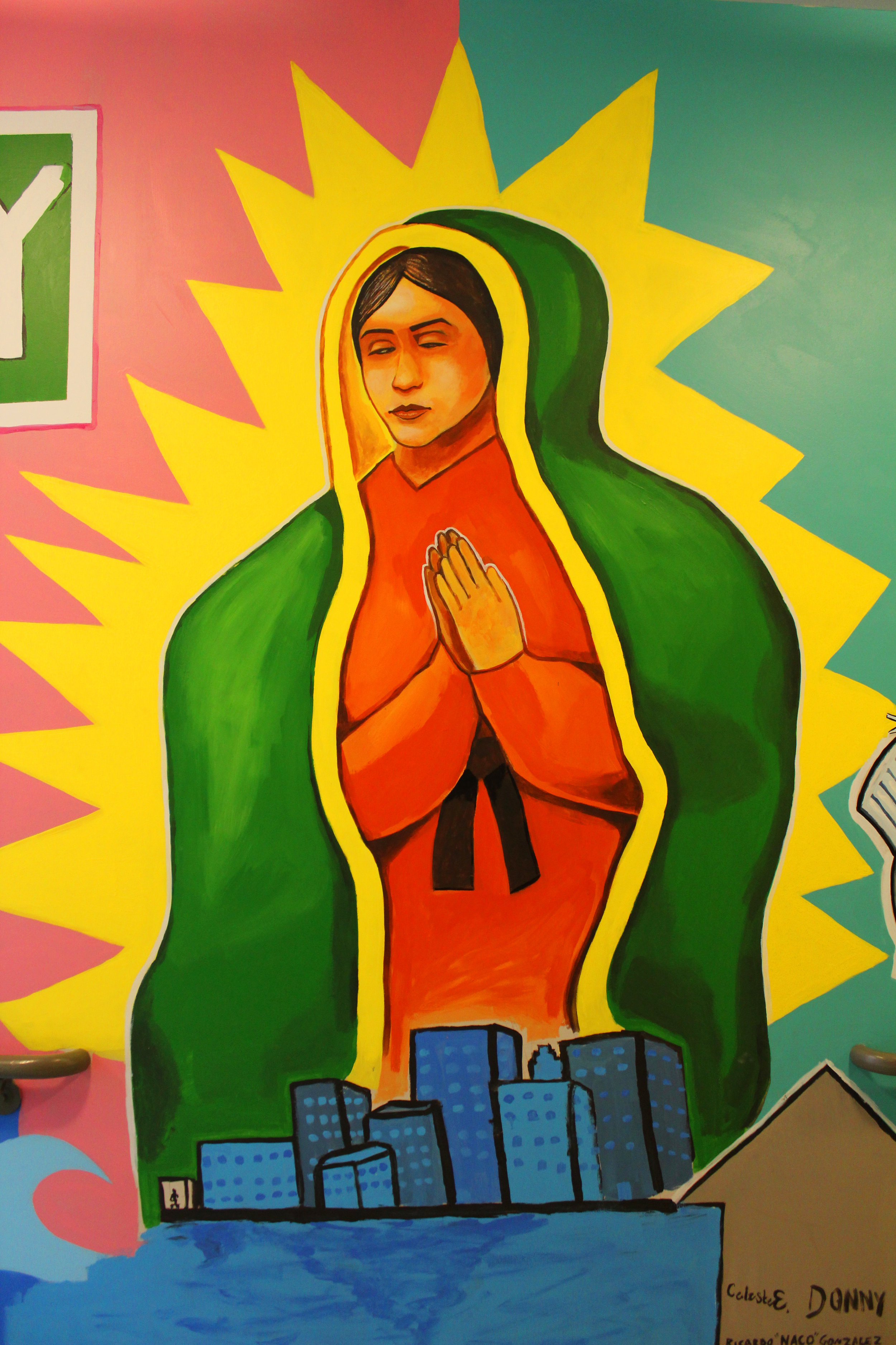 Detail of a Virgin Mary figure above the city of Grand Rapids on mural in Gallery parking ramp