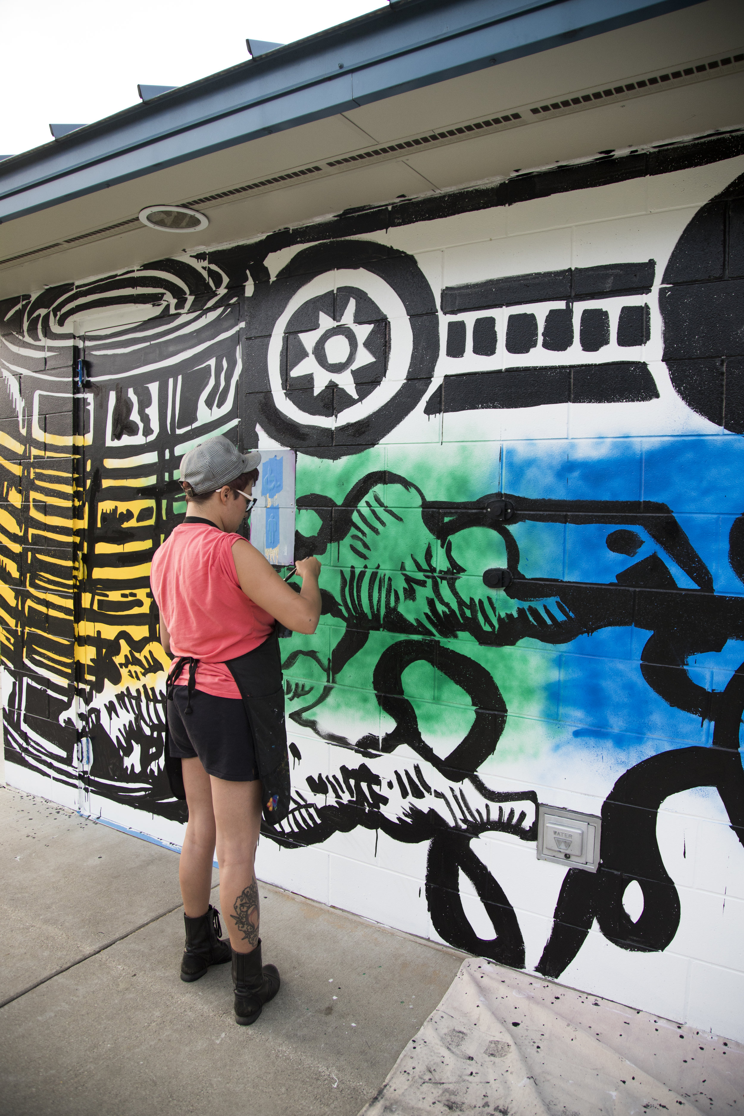 Kimberly Lavon working on mural in Baxter