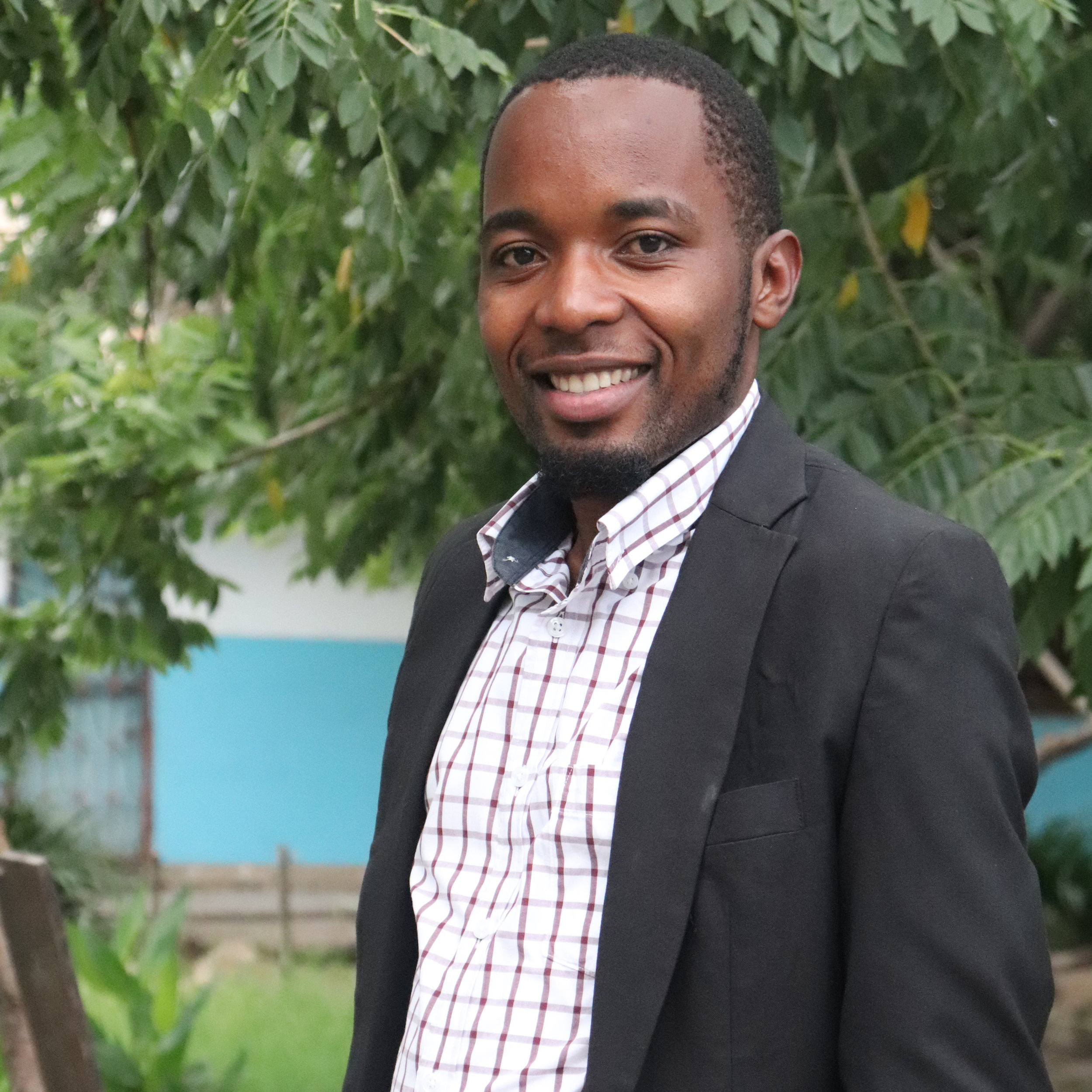 """Sadath Ahmada  FOUNDER AND EXECUTIVE SECRETARY  Sadath grew up in Nyabihanga Village, a village in Missenyi district in Kagera Region. He obtained a BA in Political Science and Public Administration in 2015 and is currently carrying out a Masters in Human Resource Management at the Open University of Tanzania. He also has a certificate in Teaching from Alharamain teachers College in 2010.  Sadath has been employed as a primary school teacher in Tabora Region since 2010 to date. While teaching, he has observed the number of orphans and vulnerable Children attending school without the necessary facilities to study properly such as school uniforms, books, pens, food and clean water. As a consequence, he decided to start supporting them at his school by using his little monthly salary, and this led to the creation of CODEWA. Sadath is now working as a an executive secretary at CODEWA.  His motto is """" the value of my life will be valued through the impacts my life brought to the lives of the Children """"."""